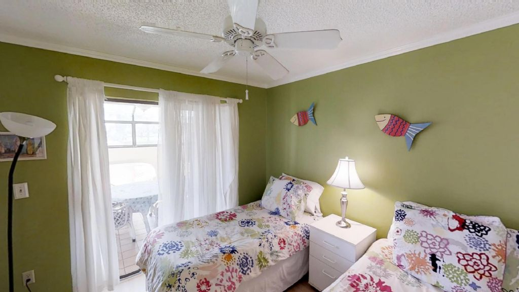 Bedroom 3 with 2 twin beds and access to sunroom