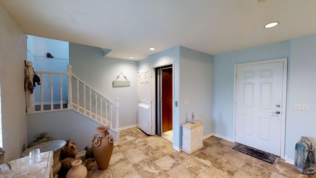 Entry Foyer with elevator and 1/2 bath