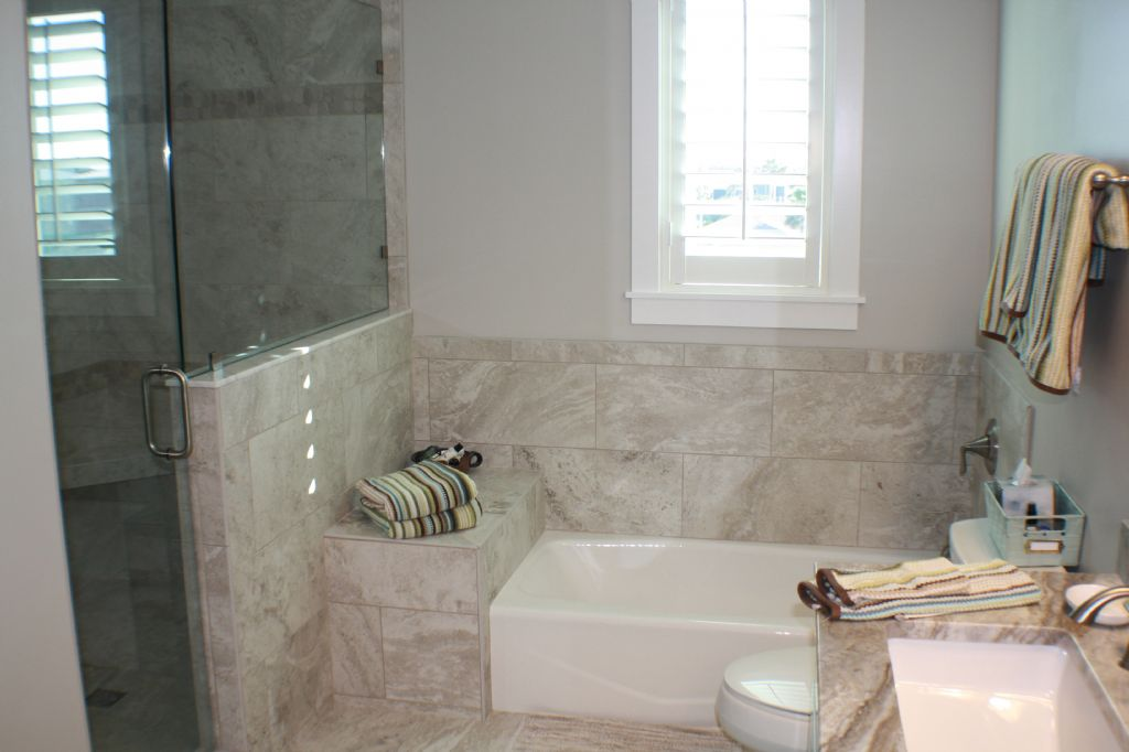 Master bath with walk in shower and soaking tub