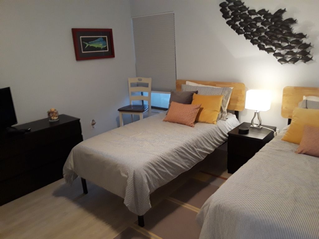 2nd Bedroom with twin beds and flat panel tv