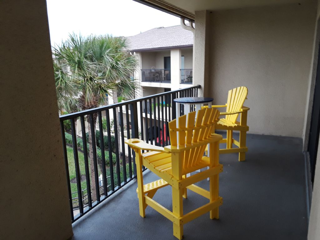relaxing chairs on covered porch