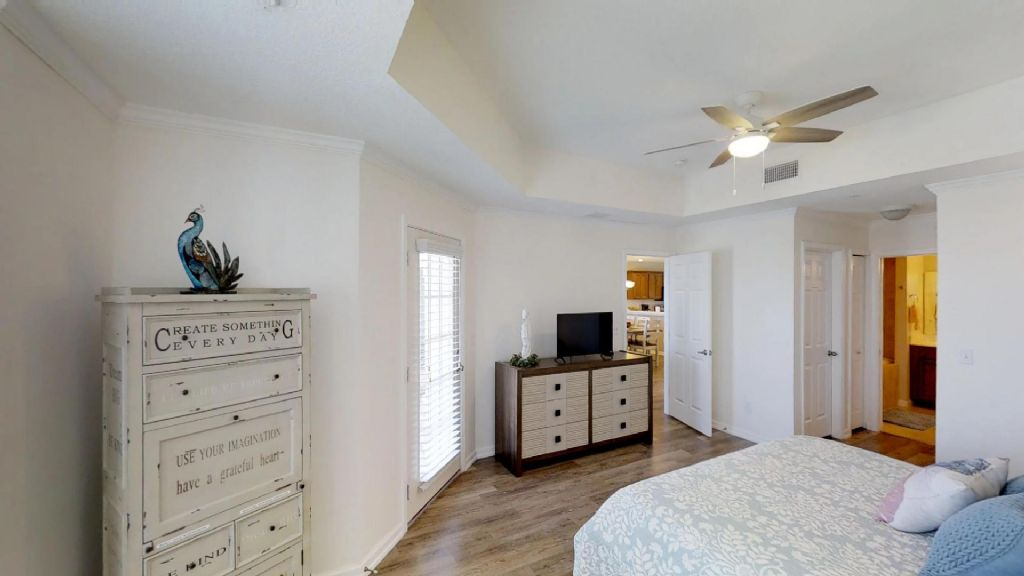 Master Bedroom with King Bed and door to porch