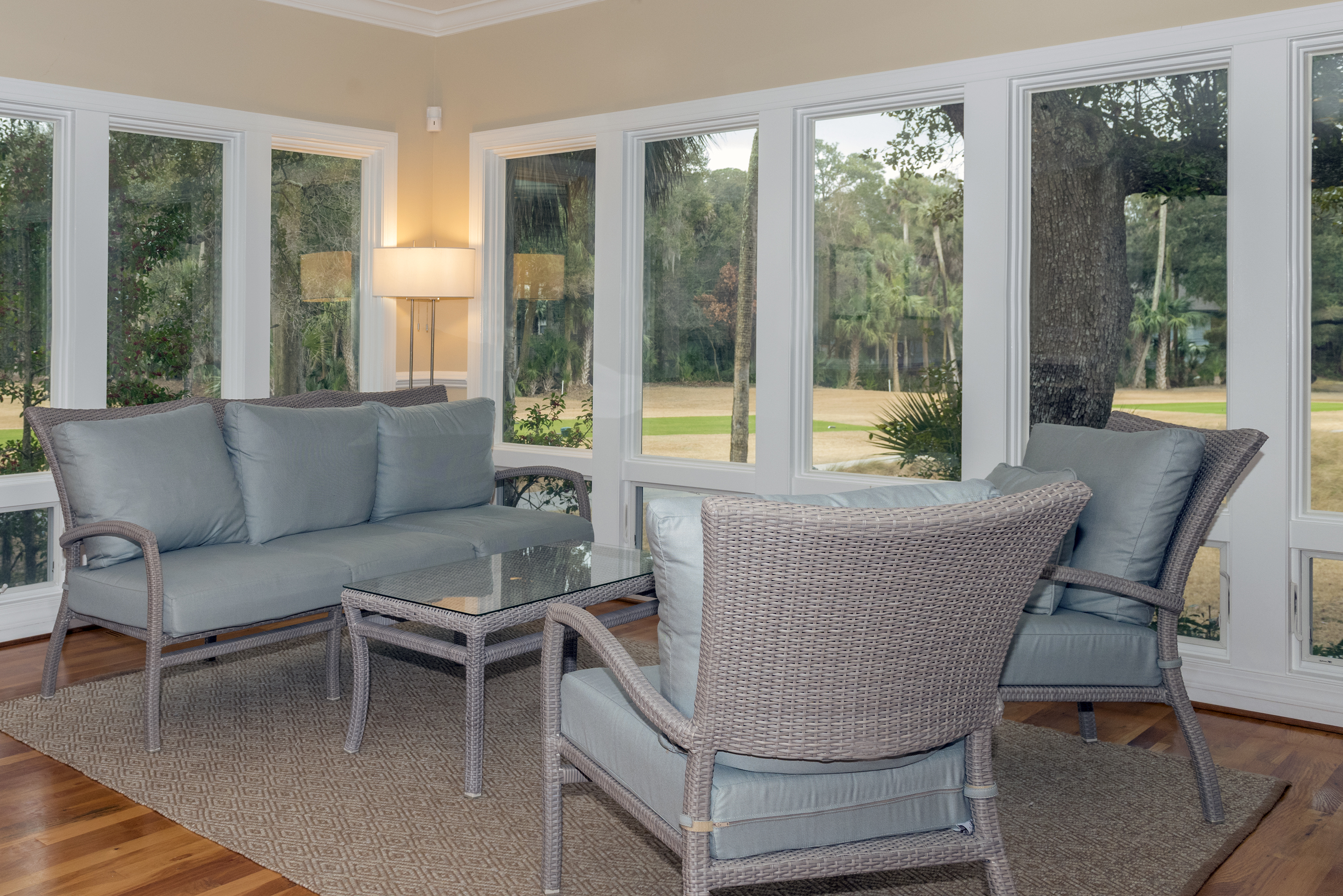 Enjoy conversation with your guests in the sun room with great views.