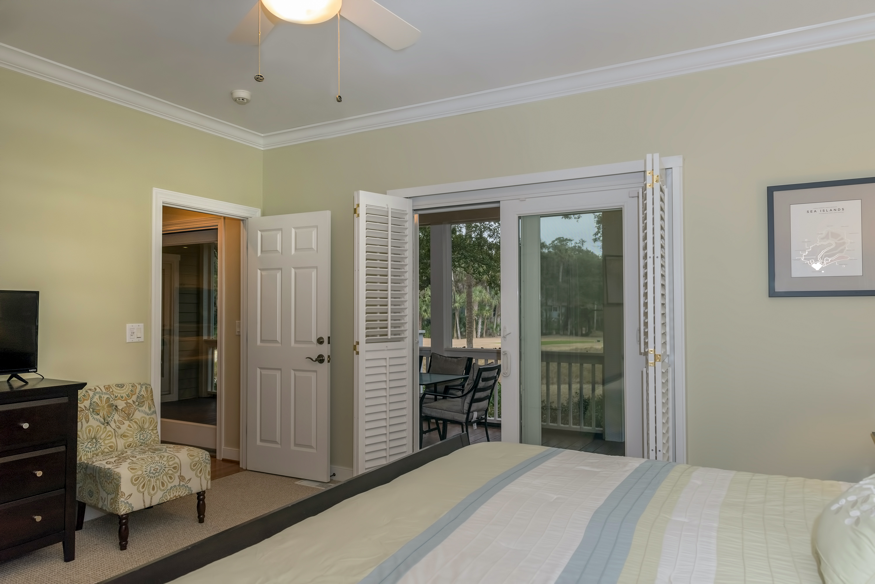 There is an HDTV and access to the screened porch.