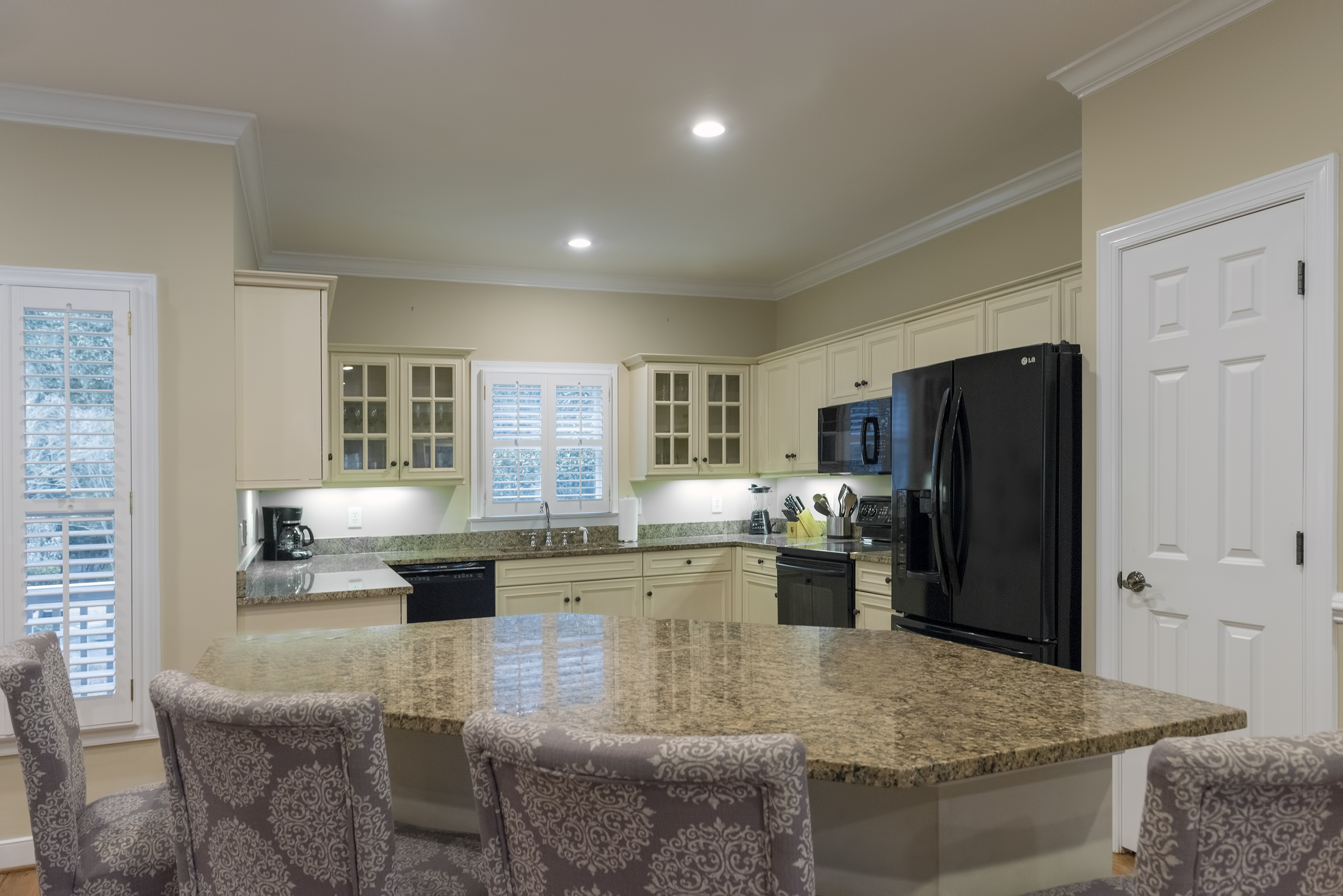 Highlights in the kitchen are granite counters and custom cabinetry.