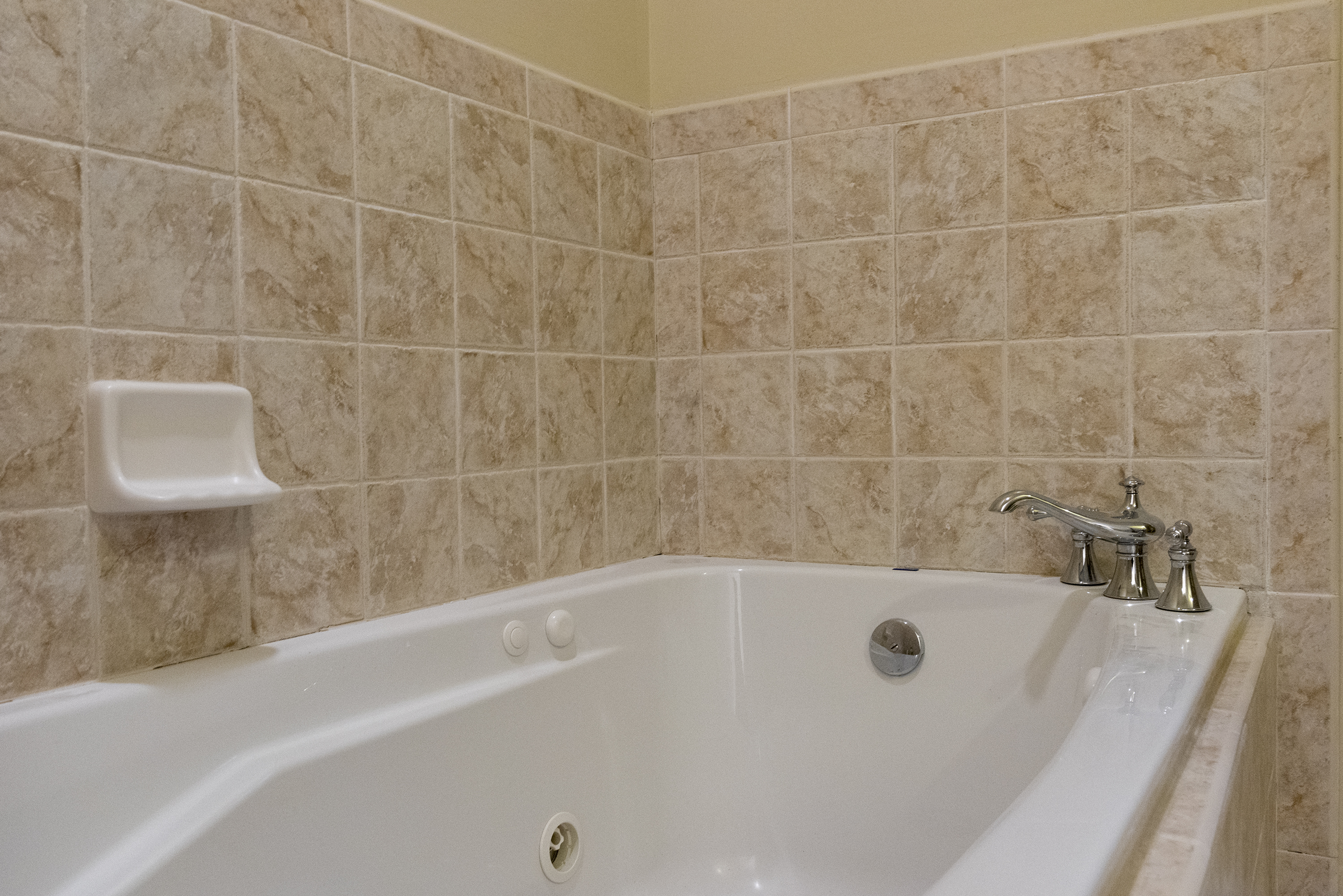 Soak in the jacuzzi tub after a day on the golf course.
