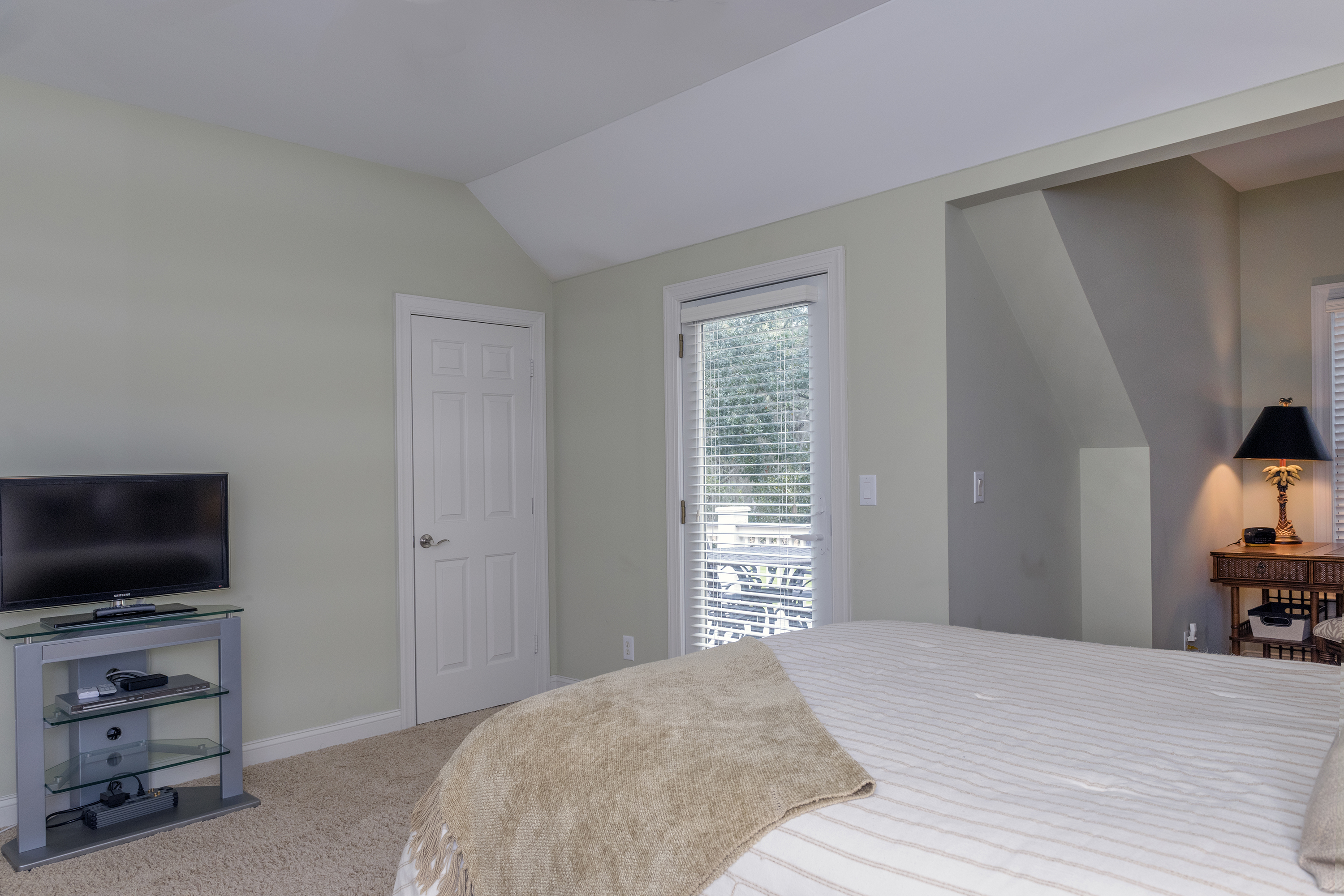 2nd bedroom is large with HDTV. There is also a door leading to the upper porch.