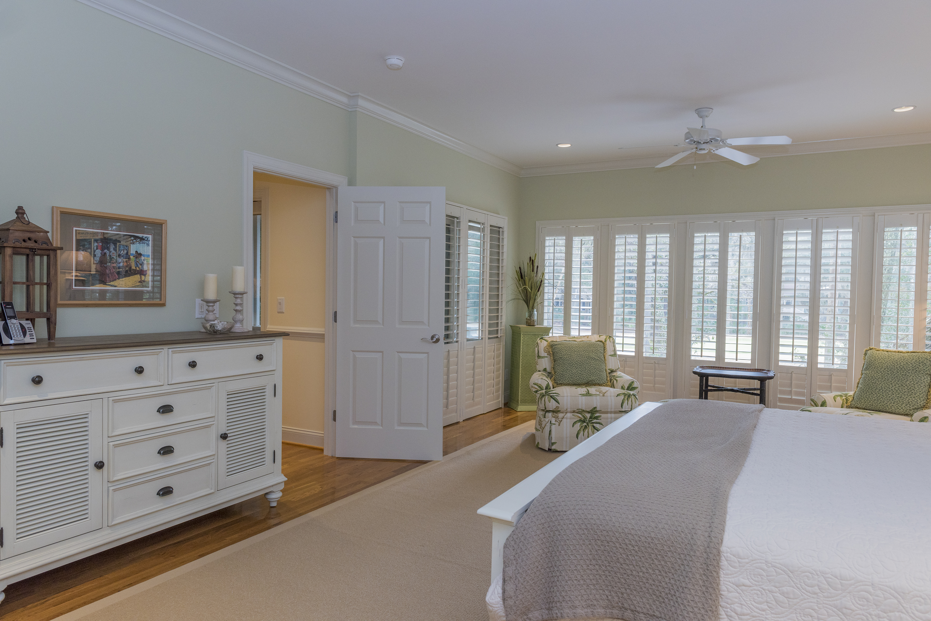The large first floor master has a king bed, new furniture, sitting area, en suite bath with large shower, and jetted tub.  Washer/Dryer in master bedroom closet as well as another washer/dryer on 2nd floor.
