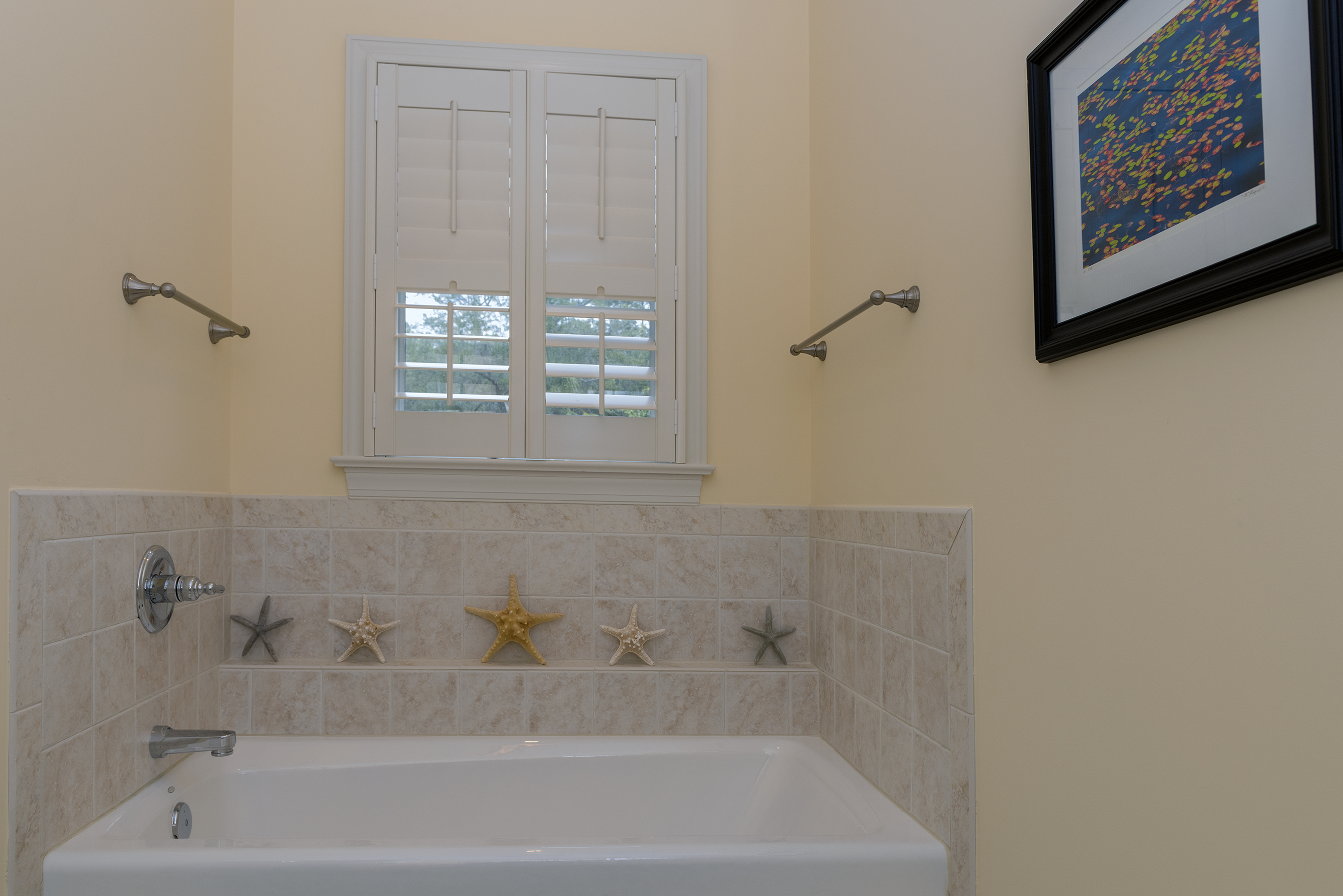 Large tub is in full bath off 2nd guest bedroom.