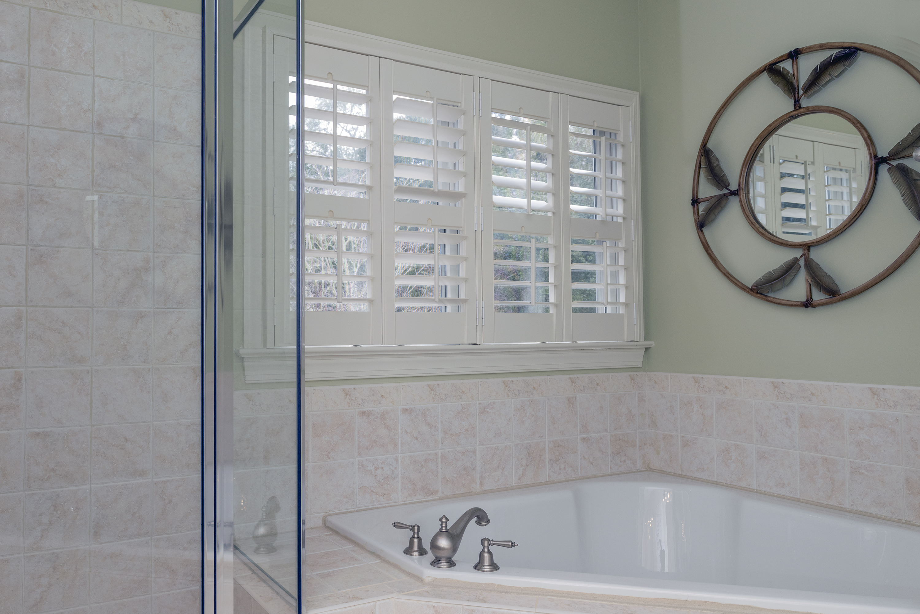 Walk-in shower and separate jetted tub accent the master bathroom.