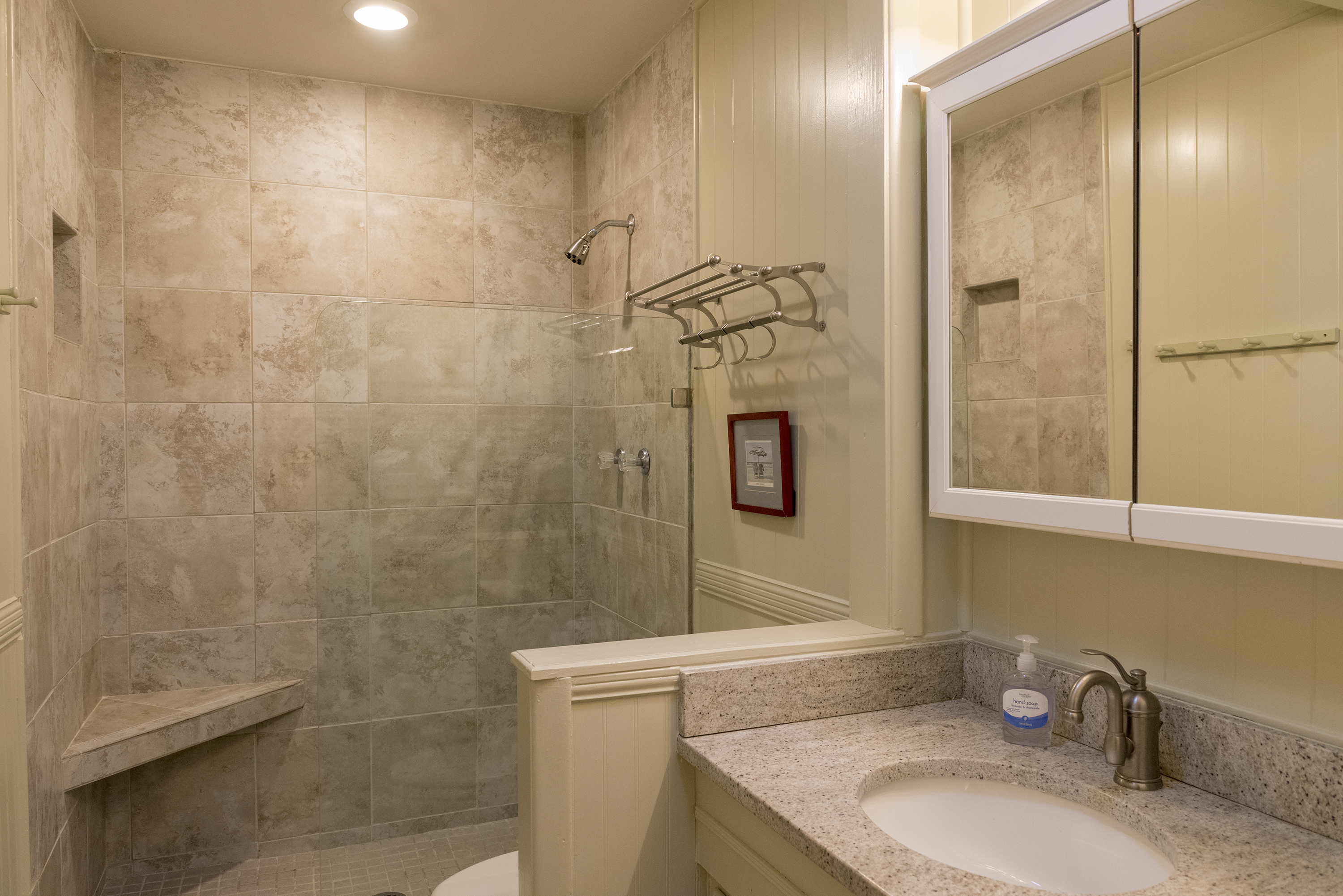 A beautiful, tiled walk-in shower is in the master bath.