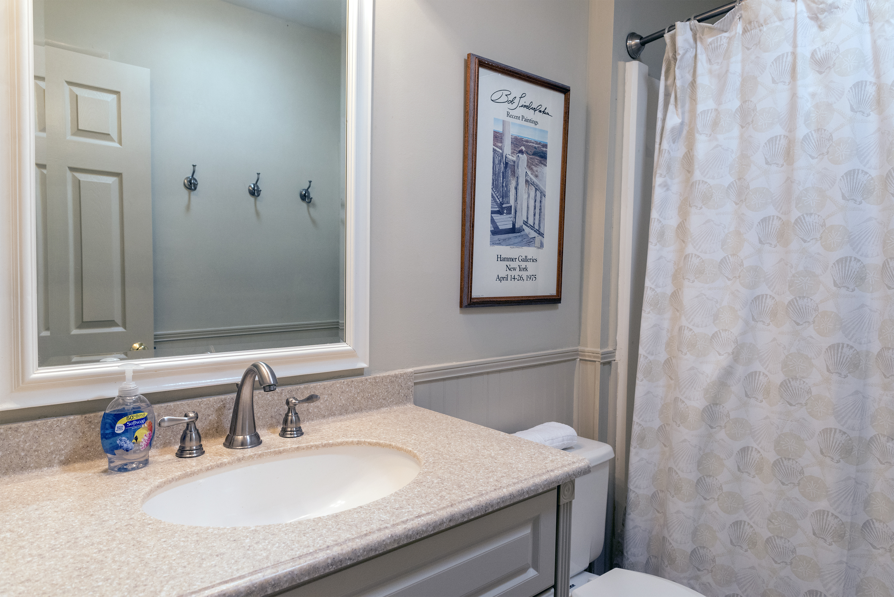 Between the two bedrooms is a full bath. It has a shower tub and has been updated.