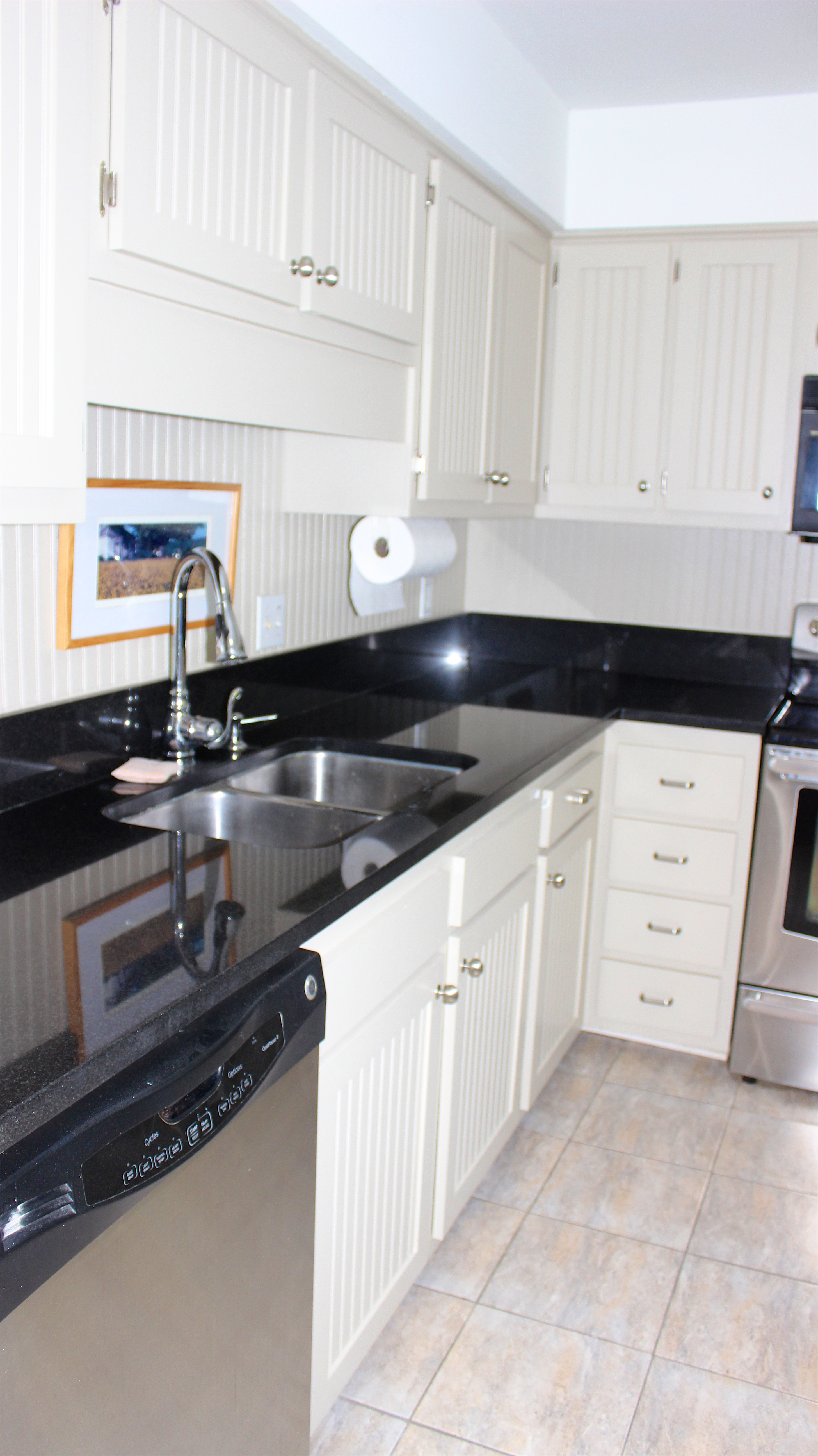 Stainless steel appliances and tile flooring are other features.