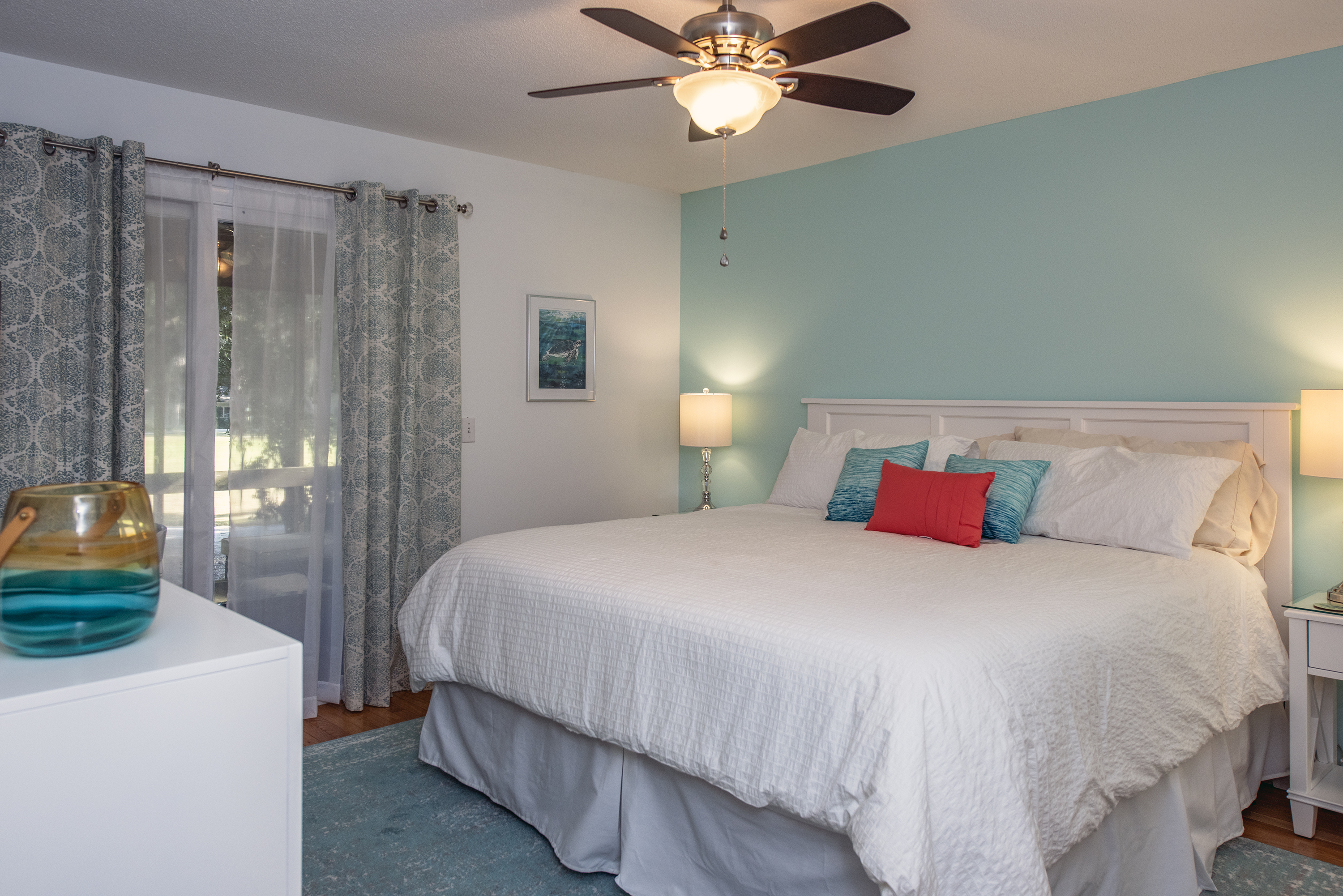 """Master bath suite has a king size bed and 32"""" HDTV."""