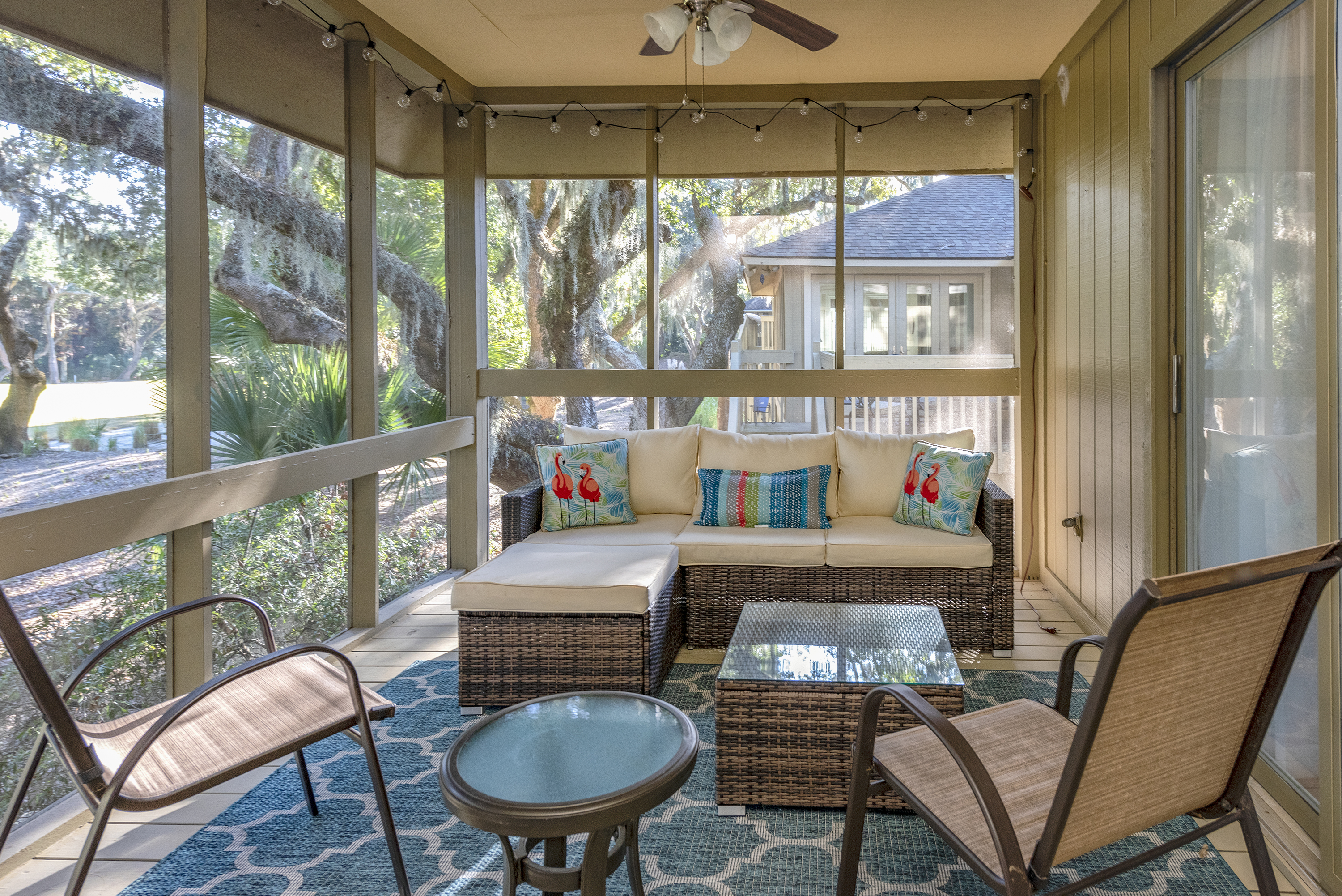 Screened in porch allows for relaxation after a day at the beach.