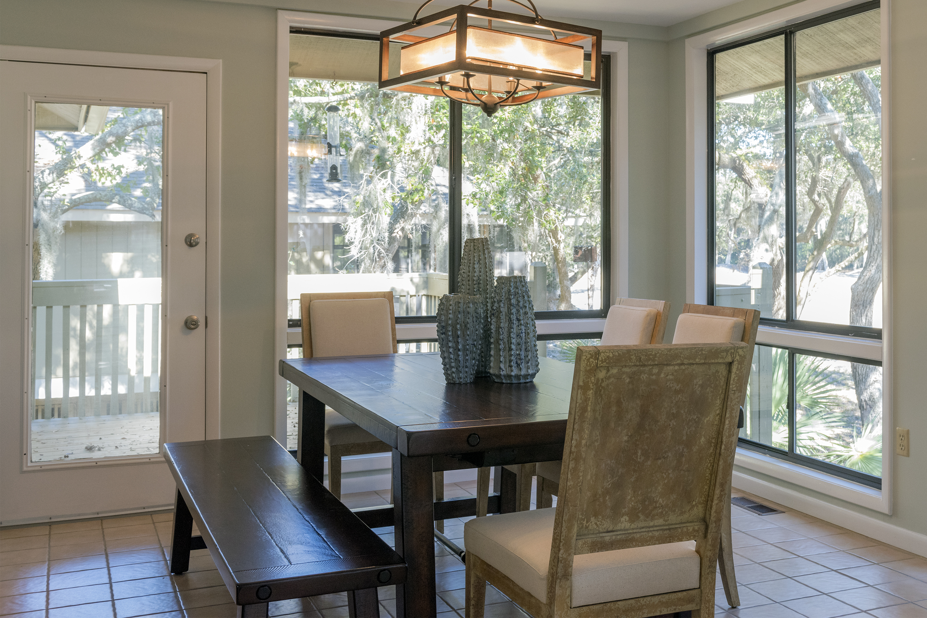 """Dining for 6-7 feels """"al fresco"""" in the four season sun room with spectacular views of Crooked Oaks golf course."""