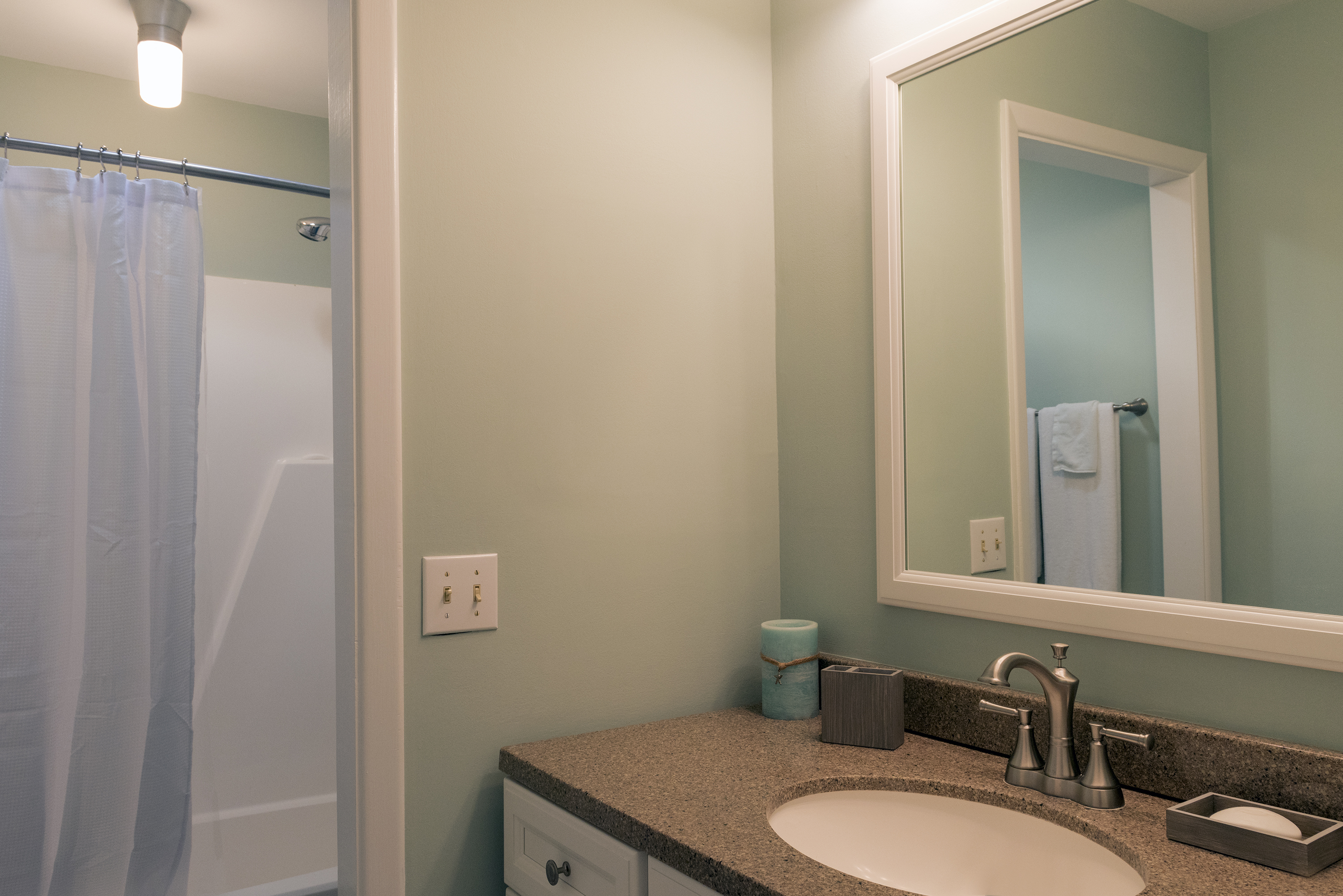 The master bath features a skylight that brightens the space.