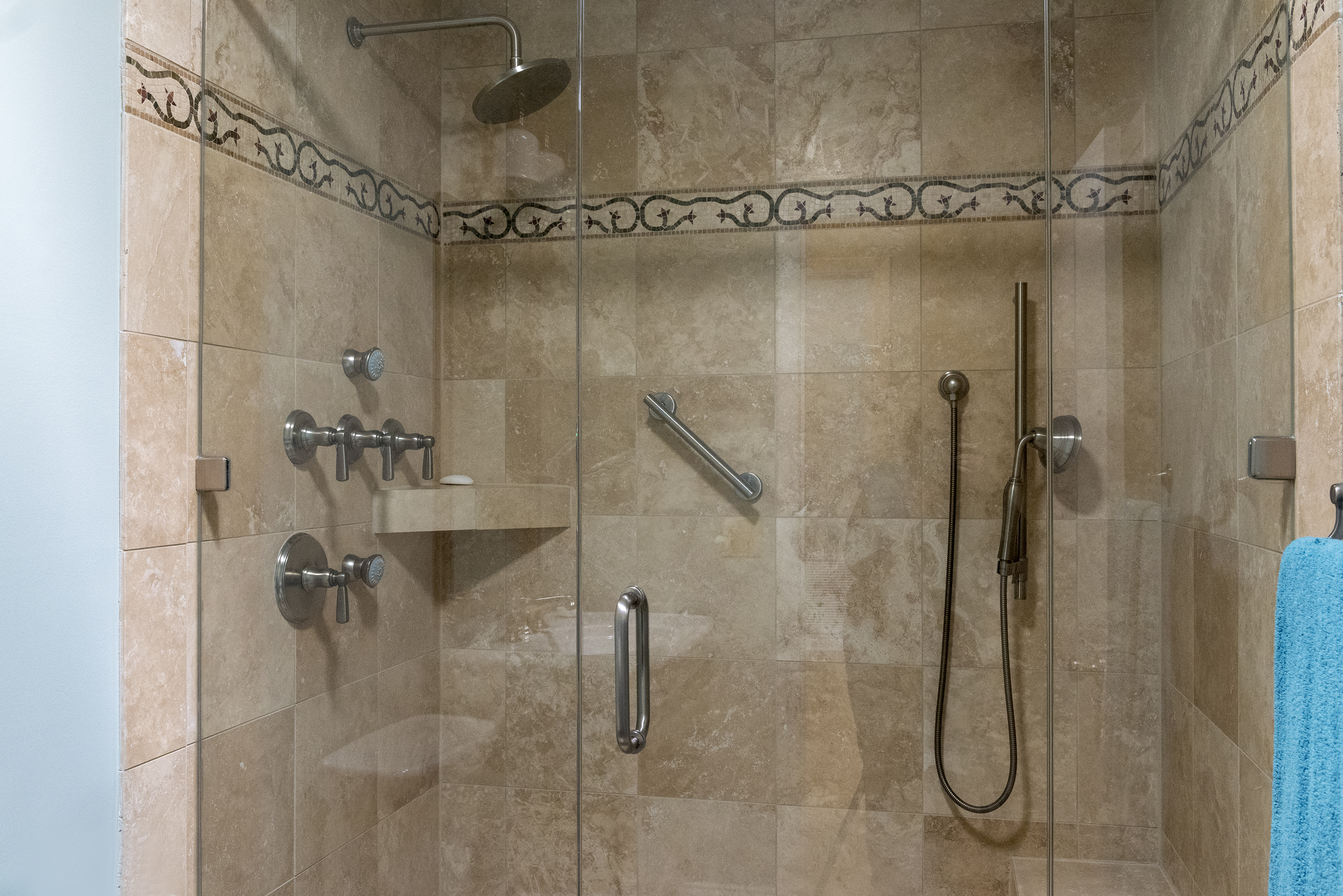 The shared guest bathroom features a fully updated walk in shower.
