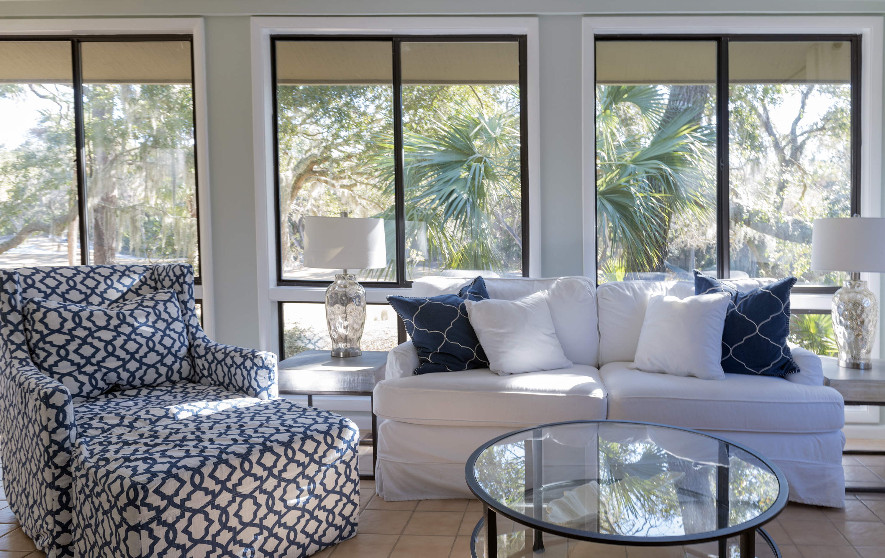 The sunroom offers panoramic views of Seabrooks natural beauty.
