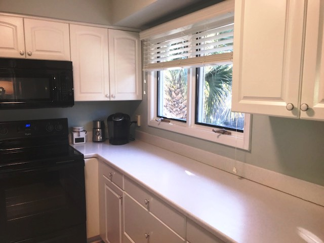 The windows on the front of the house brighten up the kitchen space.