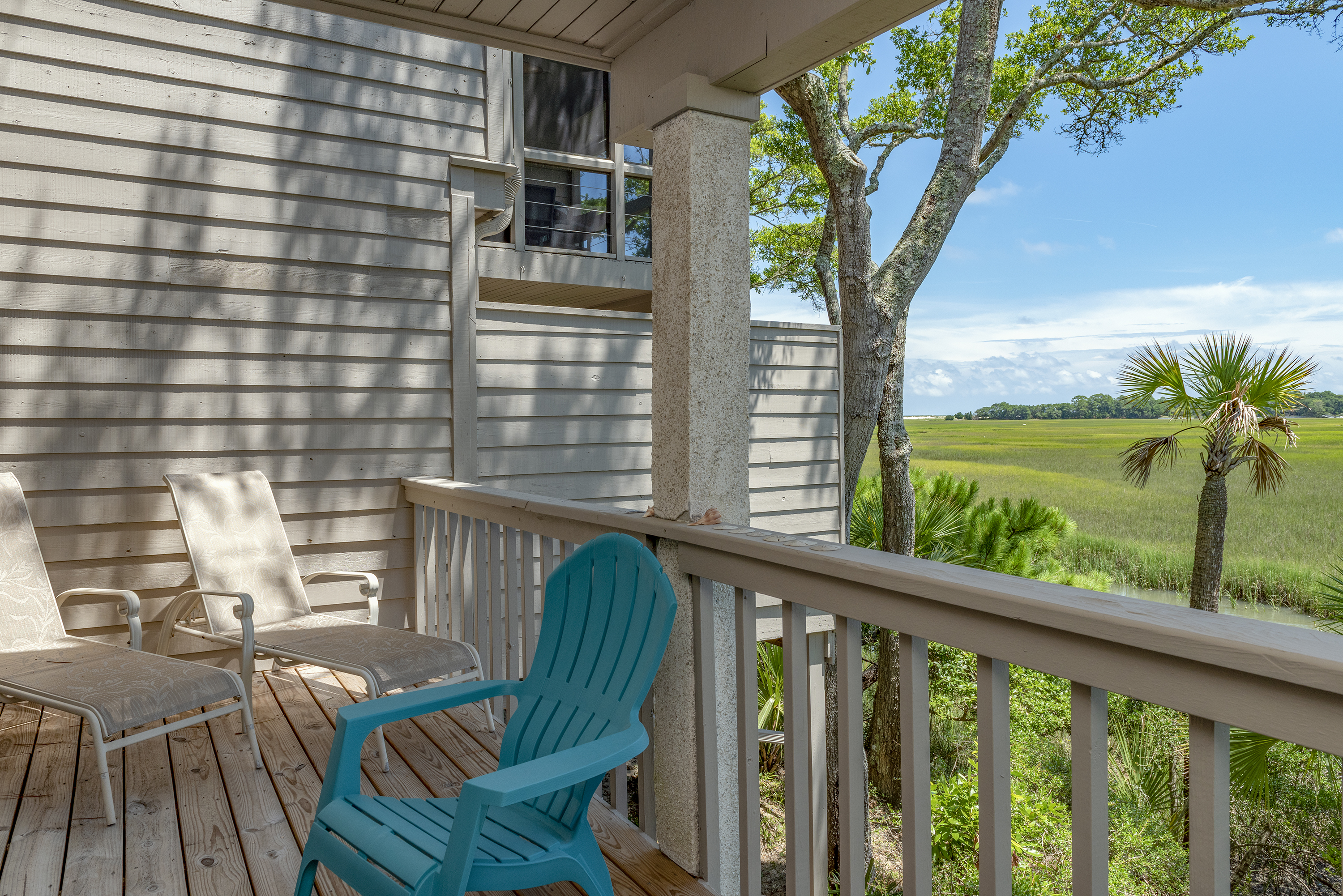1211 Creekwatch is a beautiful villa with amazing views of Capn Sams Inlet and the ocean in the distance.