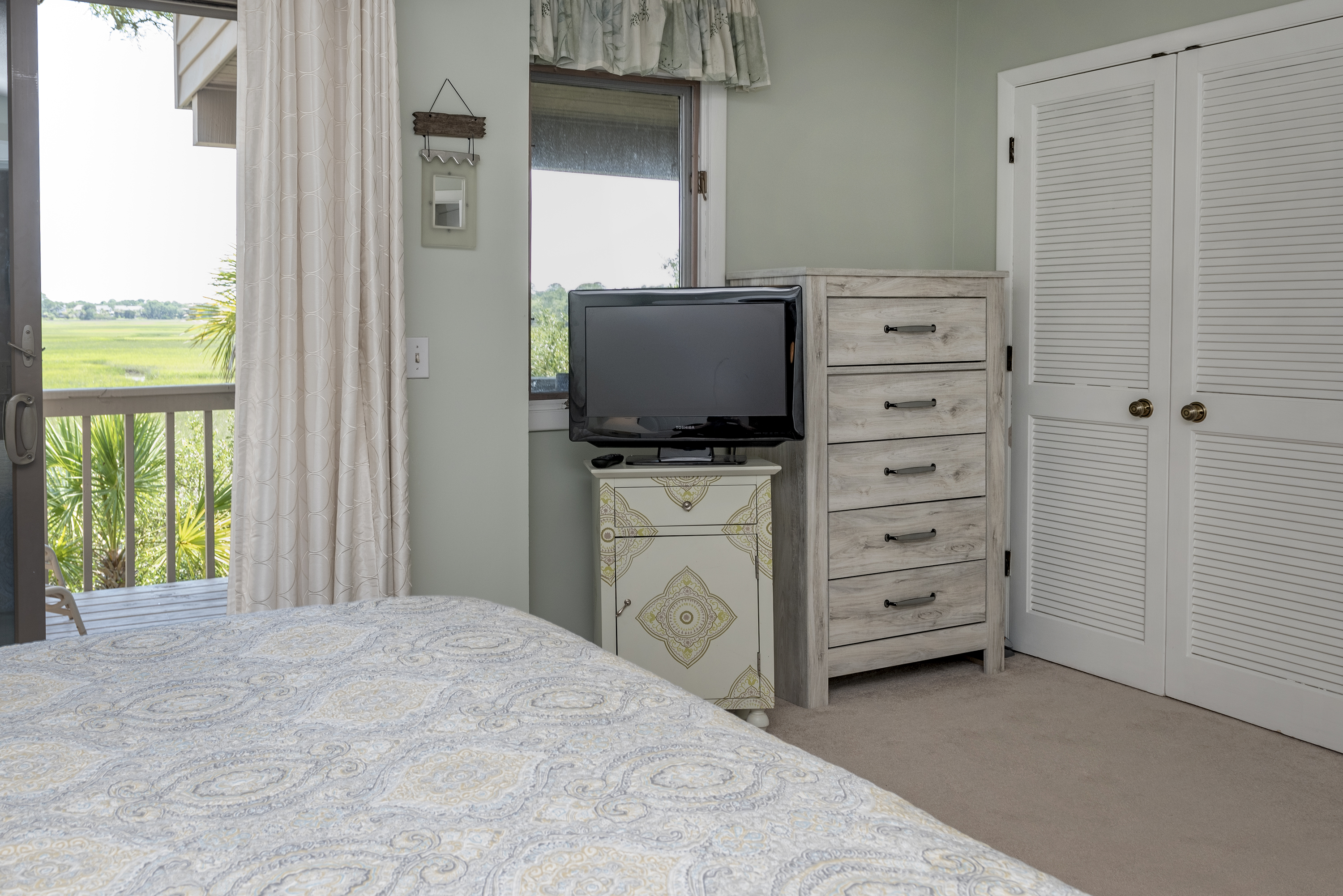 Master bedroom also has a TV, two large closets, and plenty of drawer space. We also have extra linens, pillows and blankets.