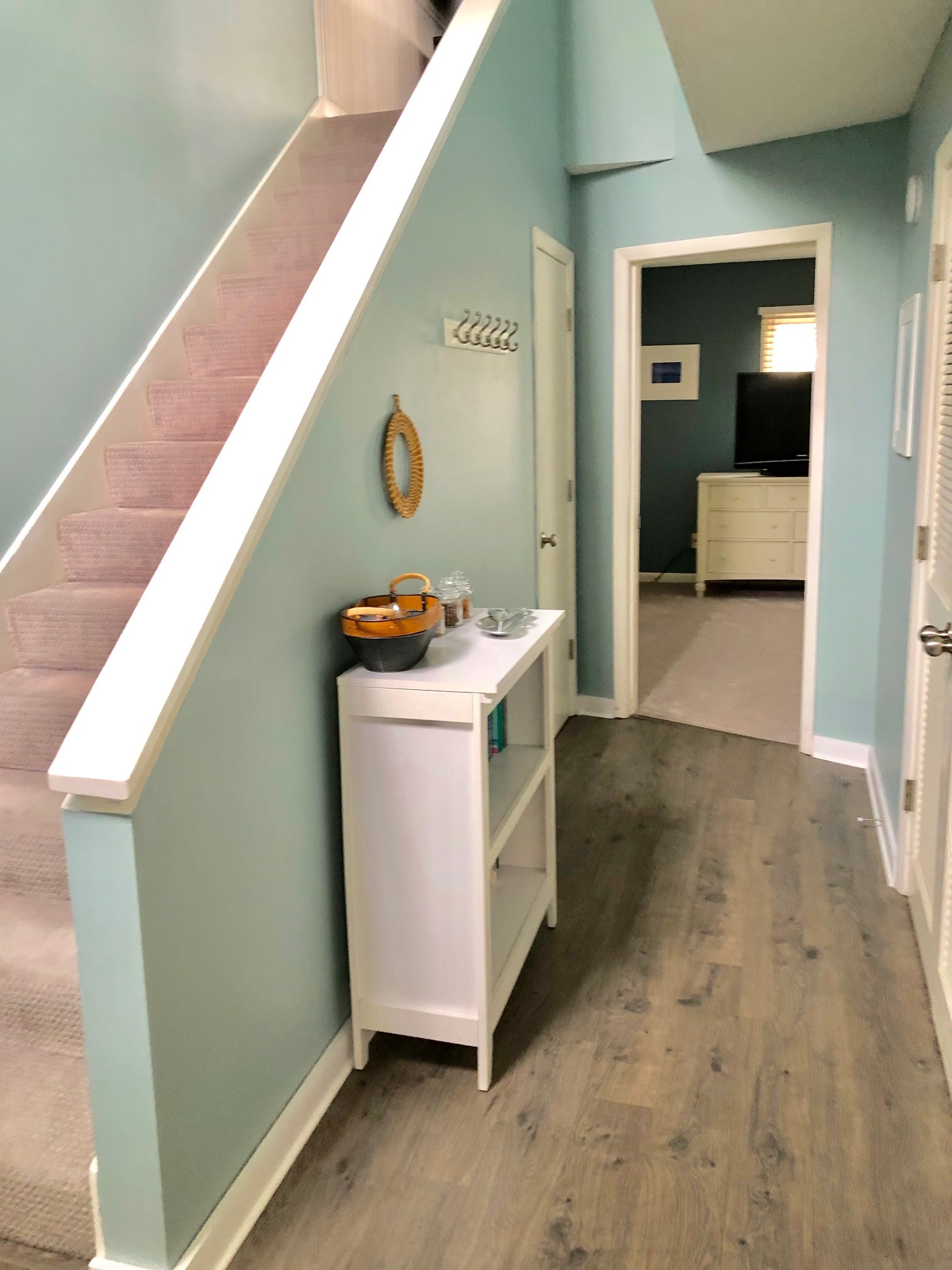 Entrance into reverse floor plan with bedrooms on lower level