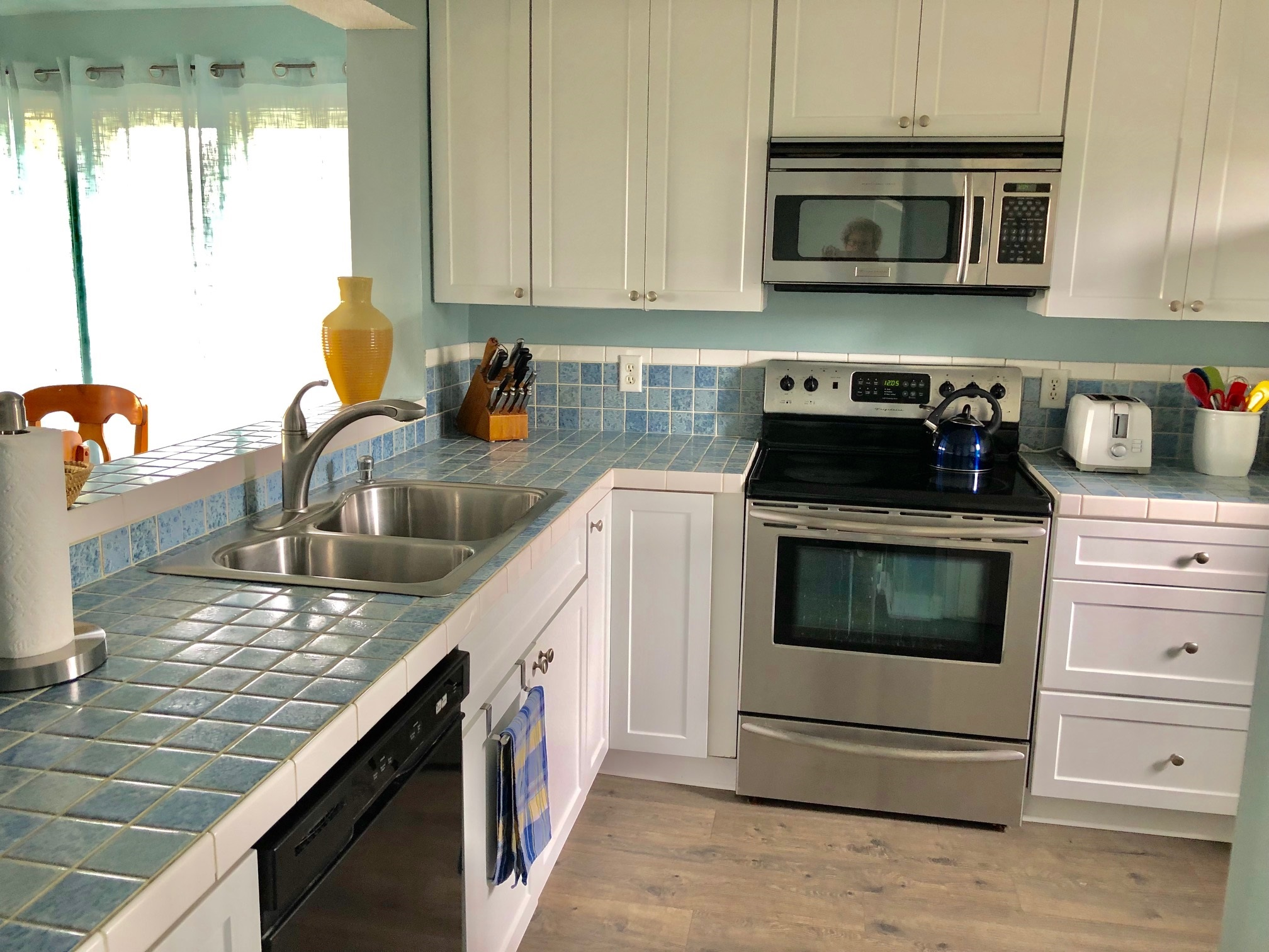 Kitchen is open to the dining and living areas