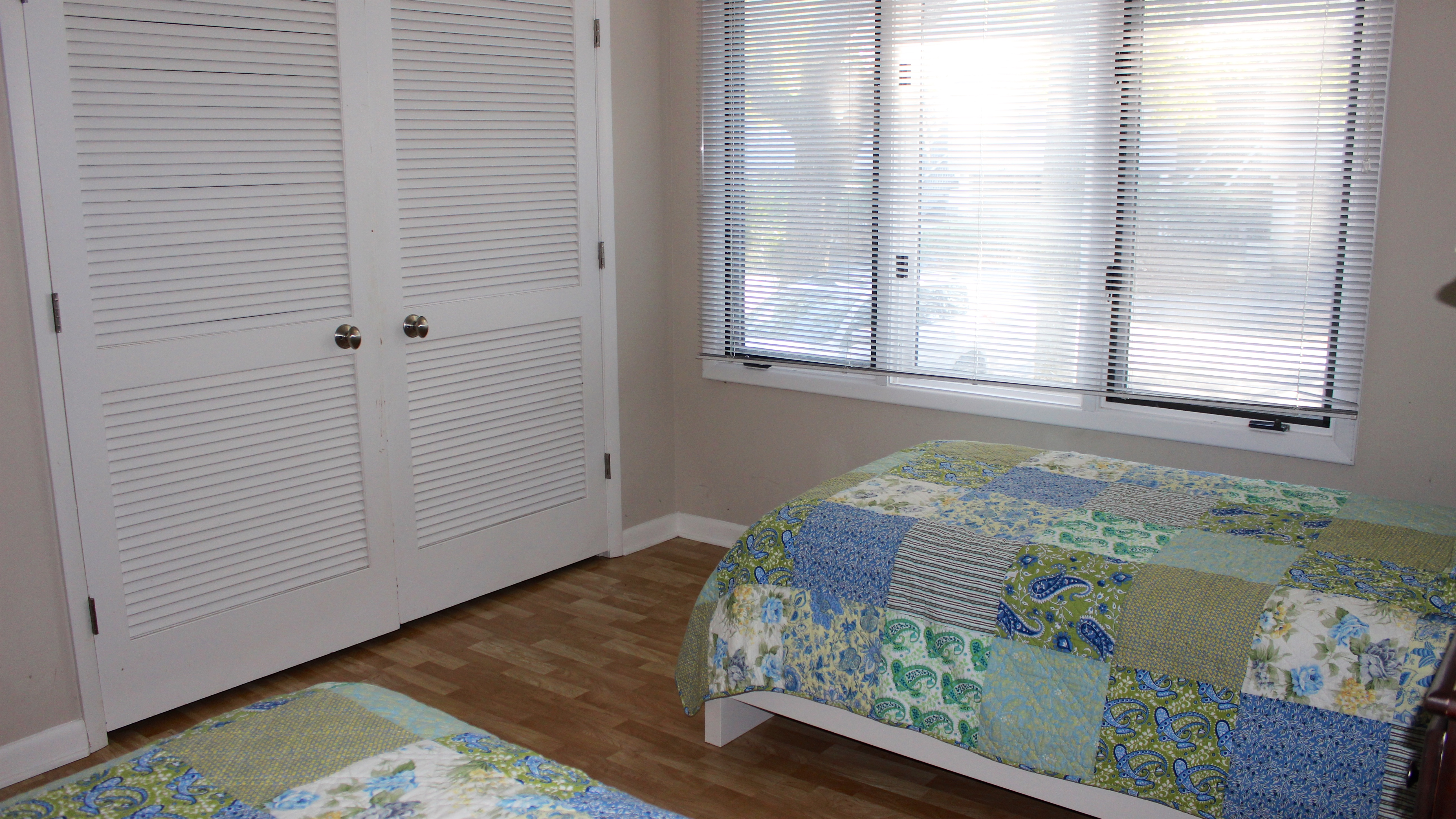 The 2nd bedroom has a large closet and windows allowing sun.