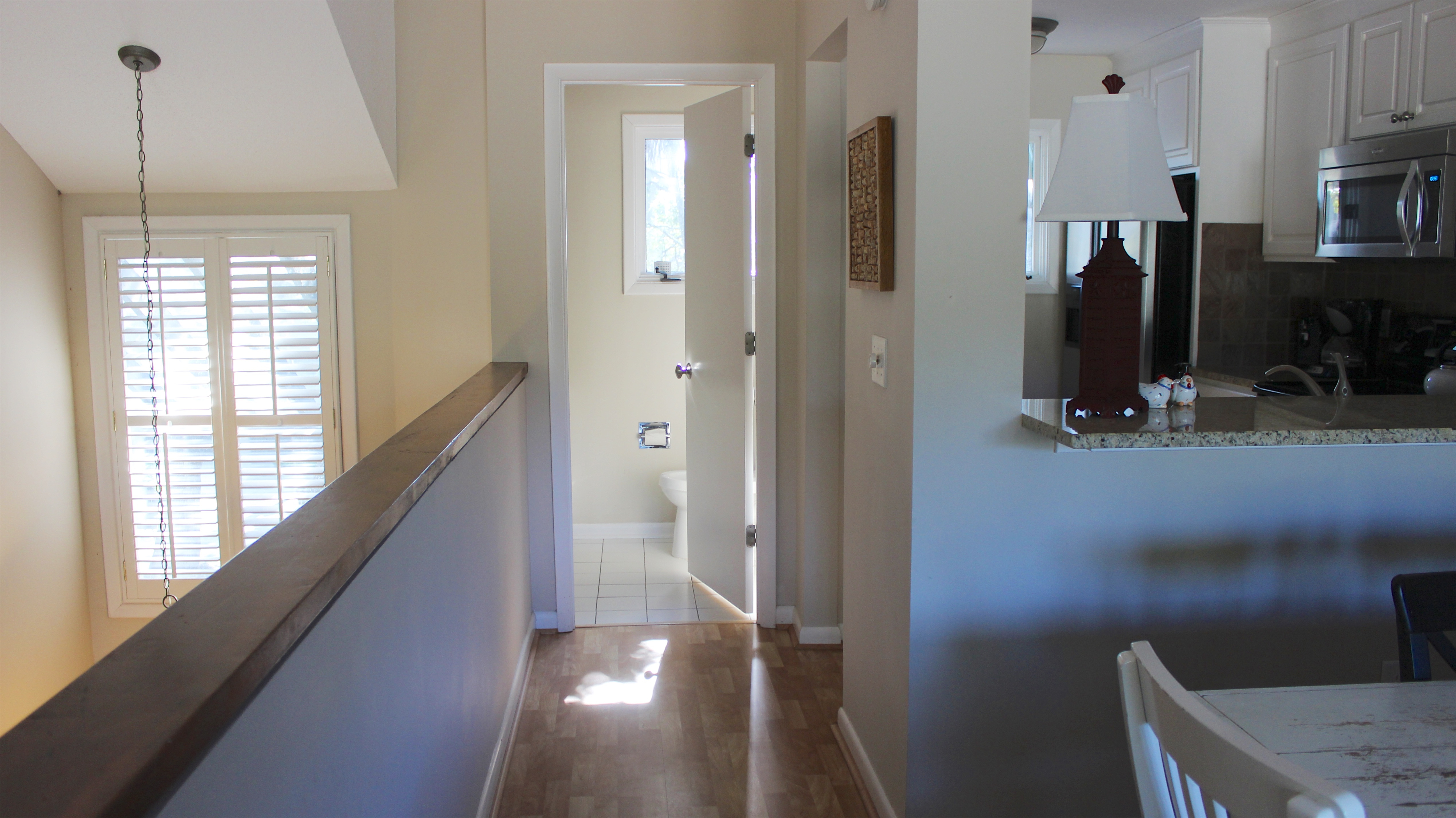 Next to the kitchen is a powder room.
