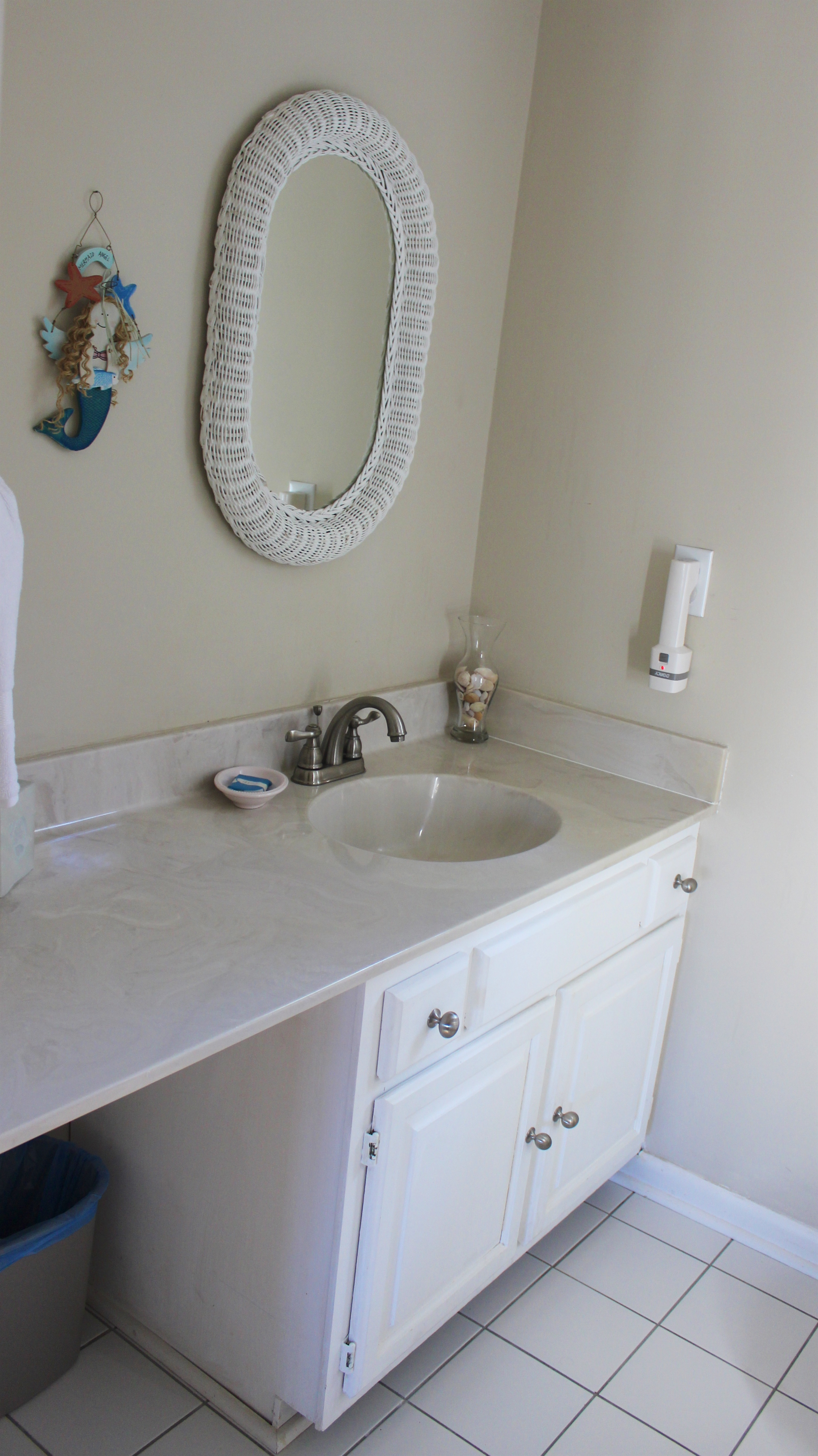It has a large vanity and file flooring.