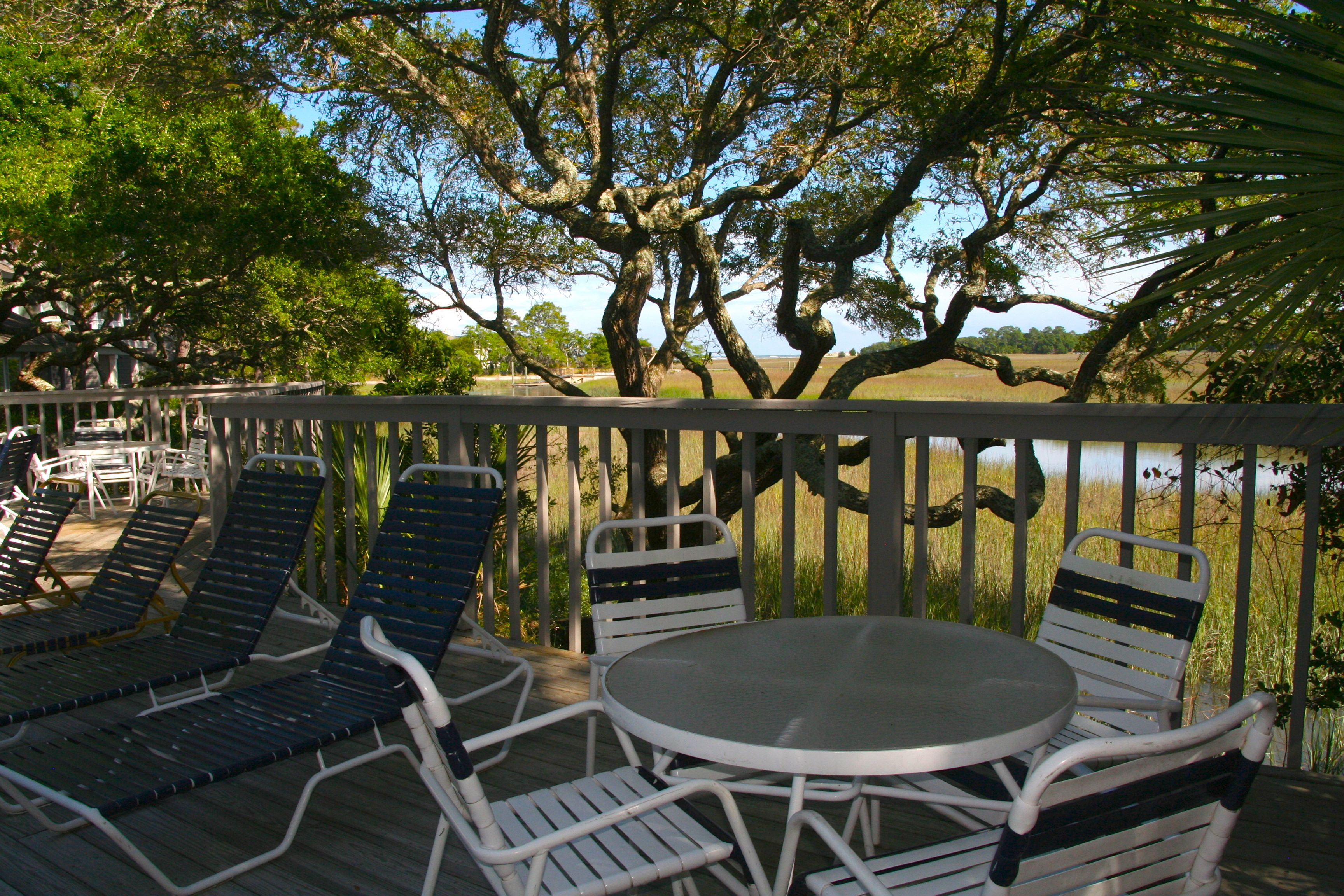 A short walk from the villa, there are chaises and tables/chairs for you to relax in.