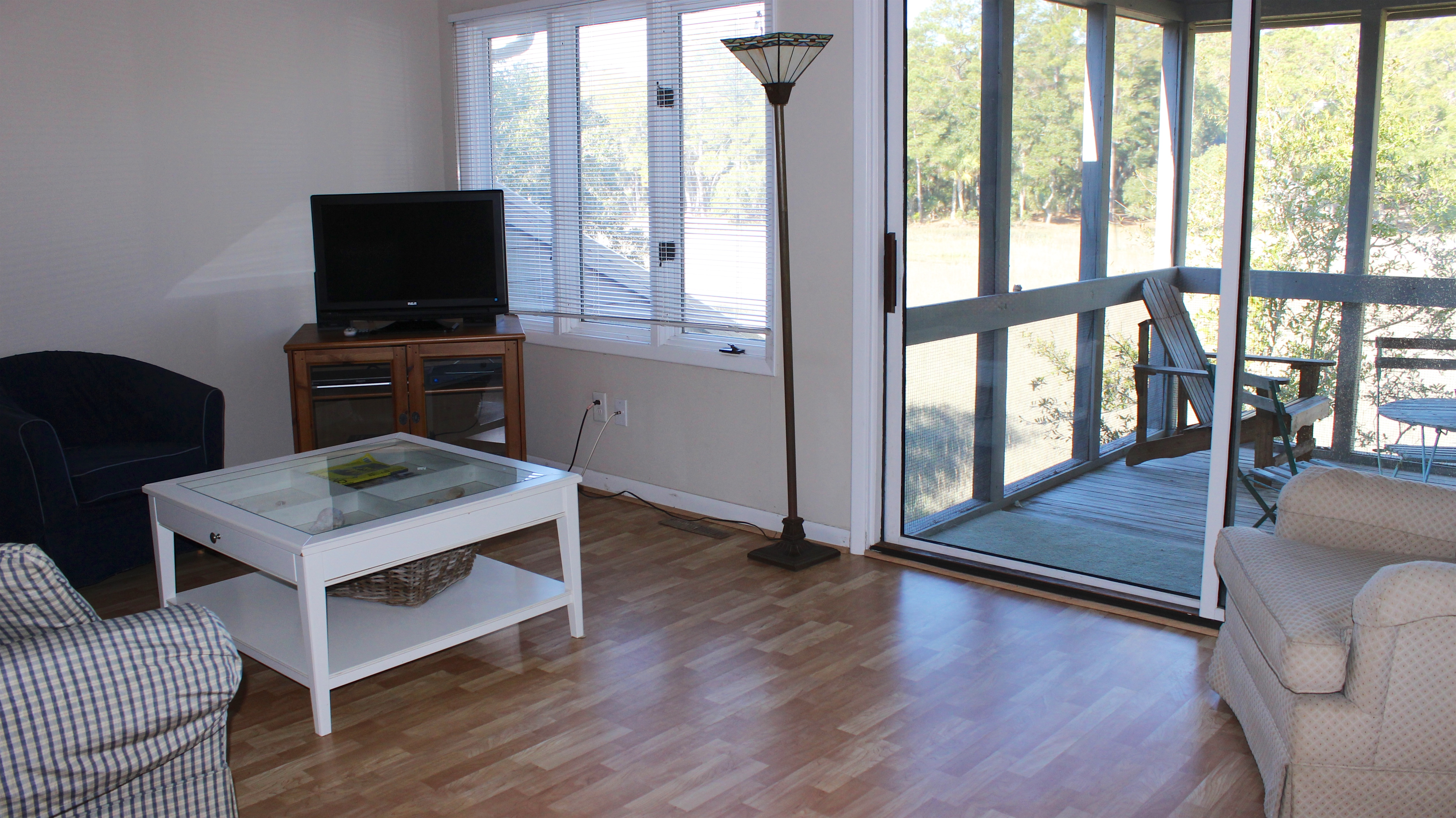 Sliding doors lead to a screened porch.