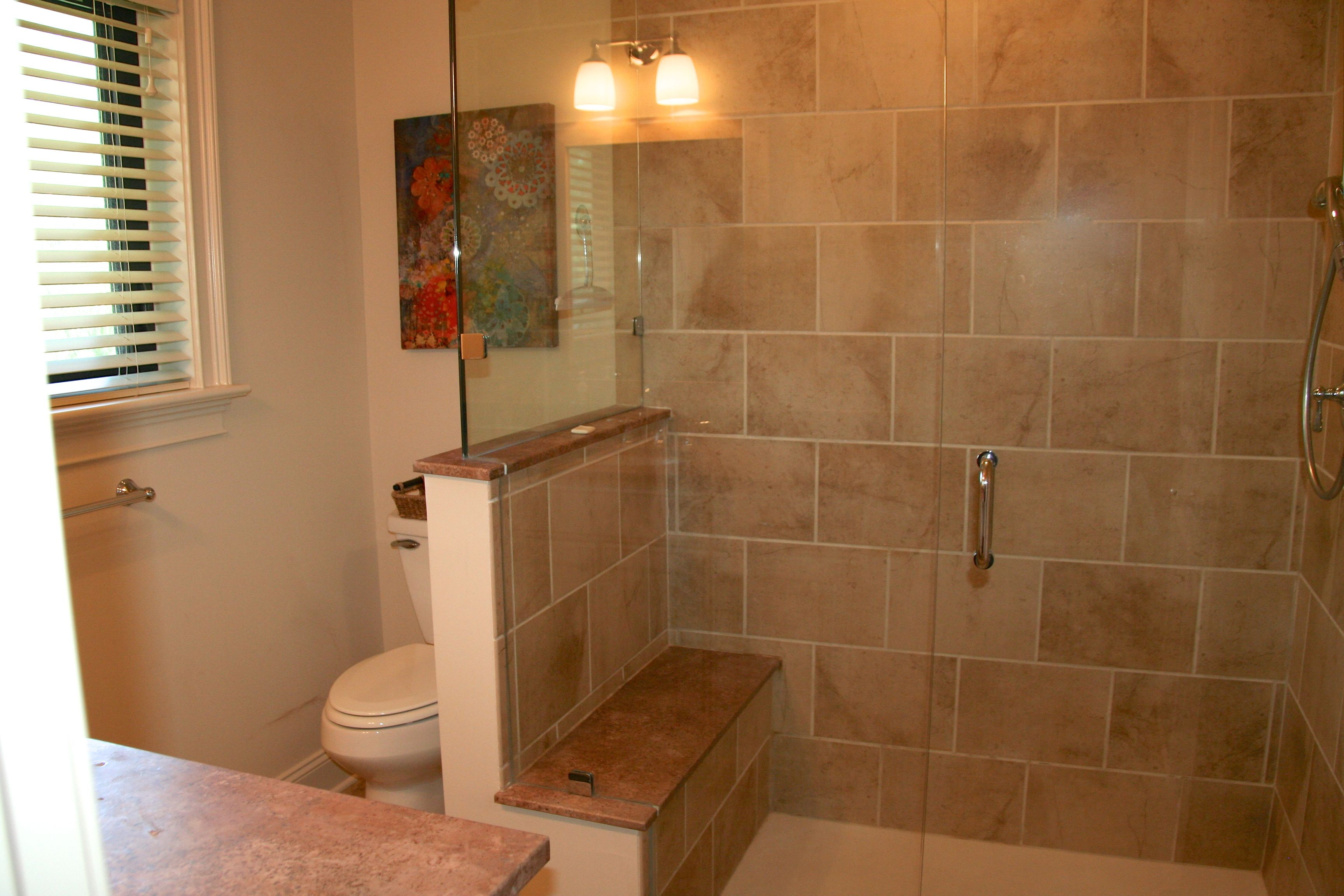 This amazing bath has been completely renovated and has an extra large shower.