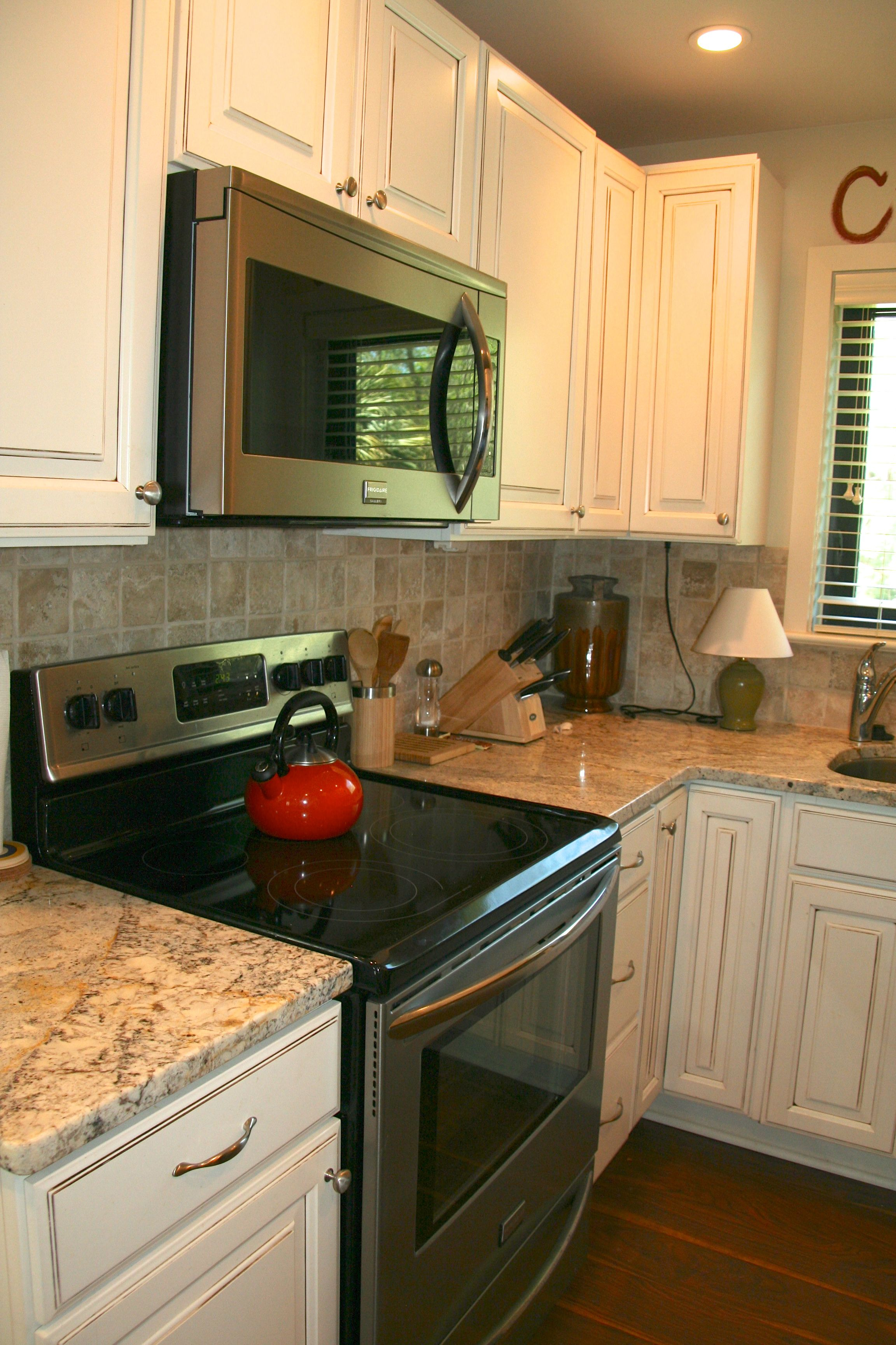 The updated kitchen boasts granite counters & stainless appliances.