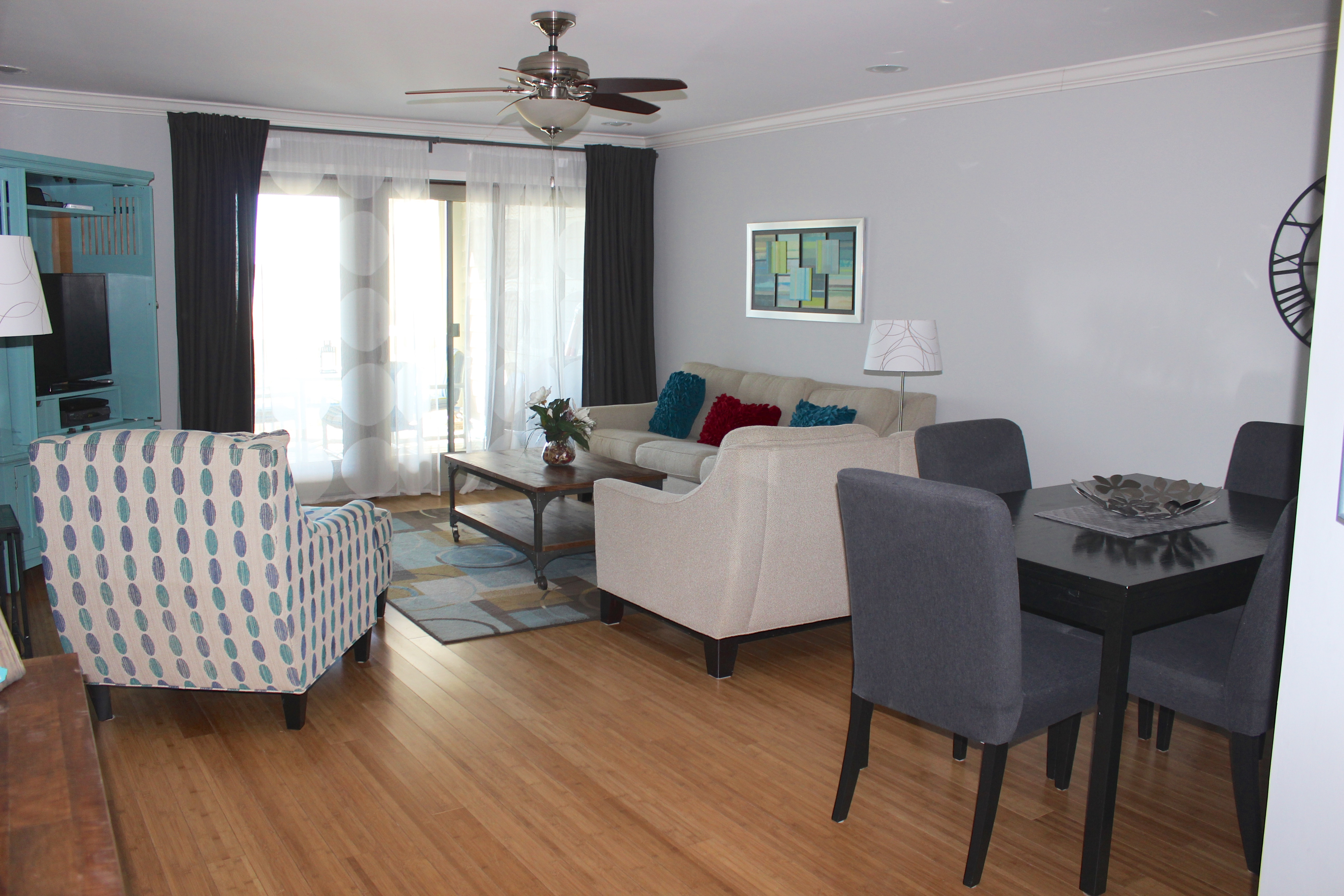 Features include bamboo floors & a soothing gray/aqua decor.