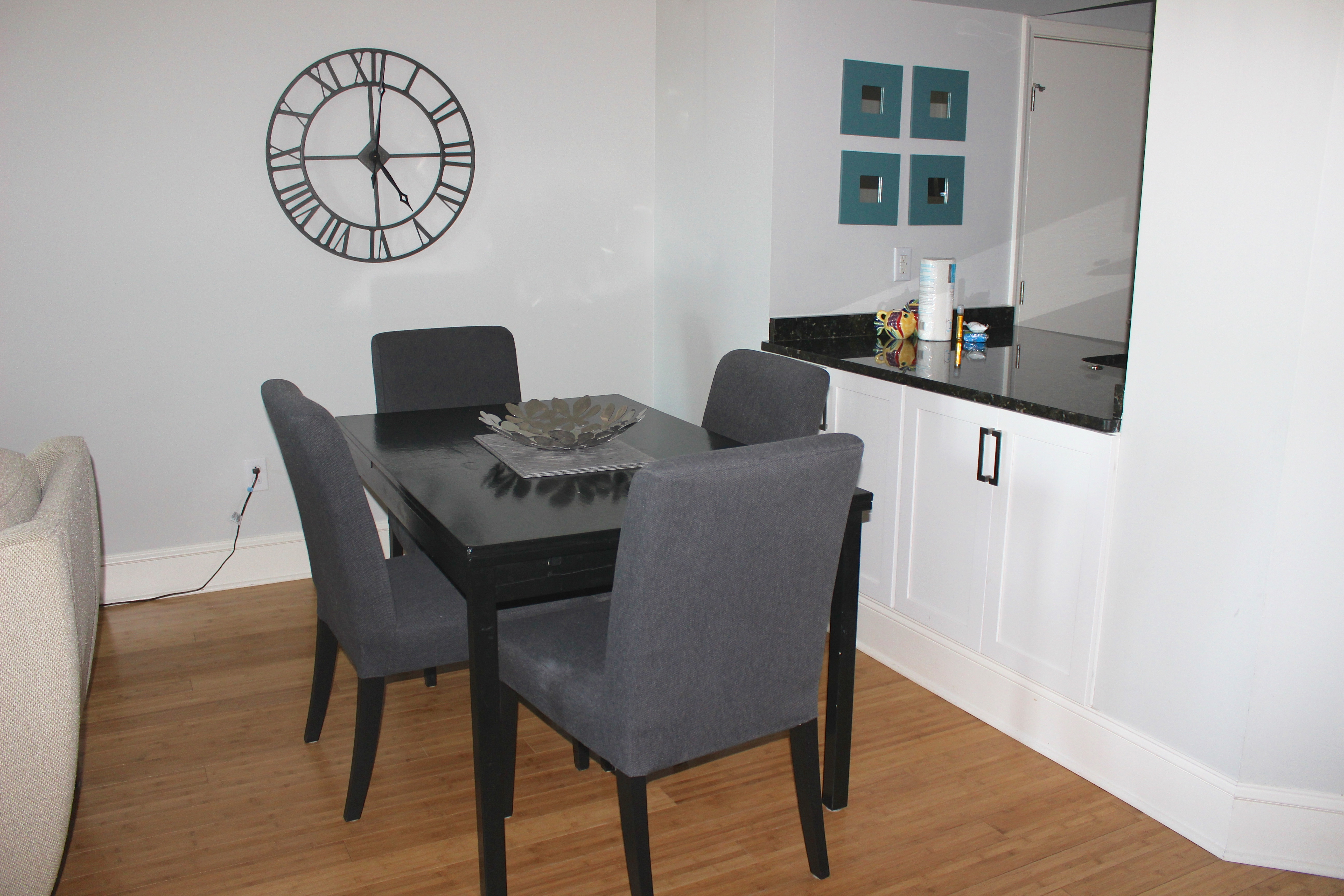 The kitchen opens into the living/dining area.