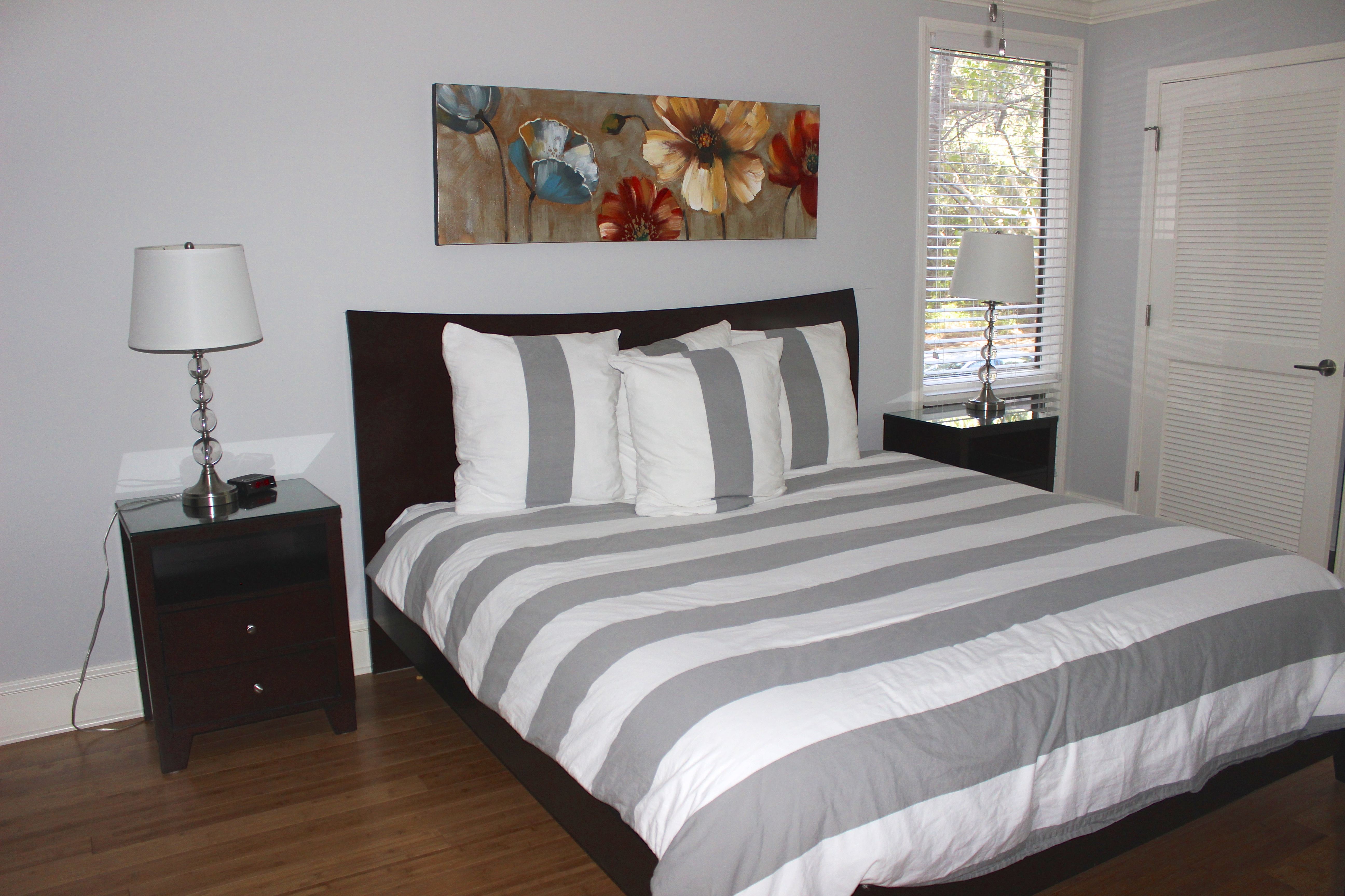 The master bedroom is a true retreat featuring a king bed & contemporary design.