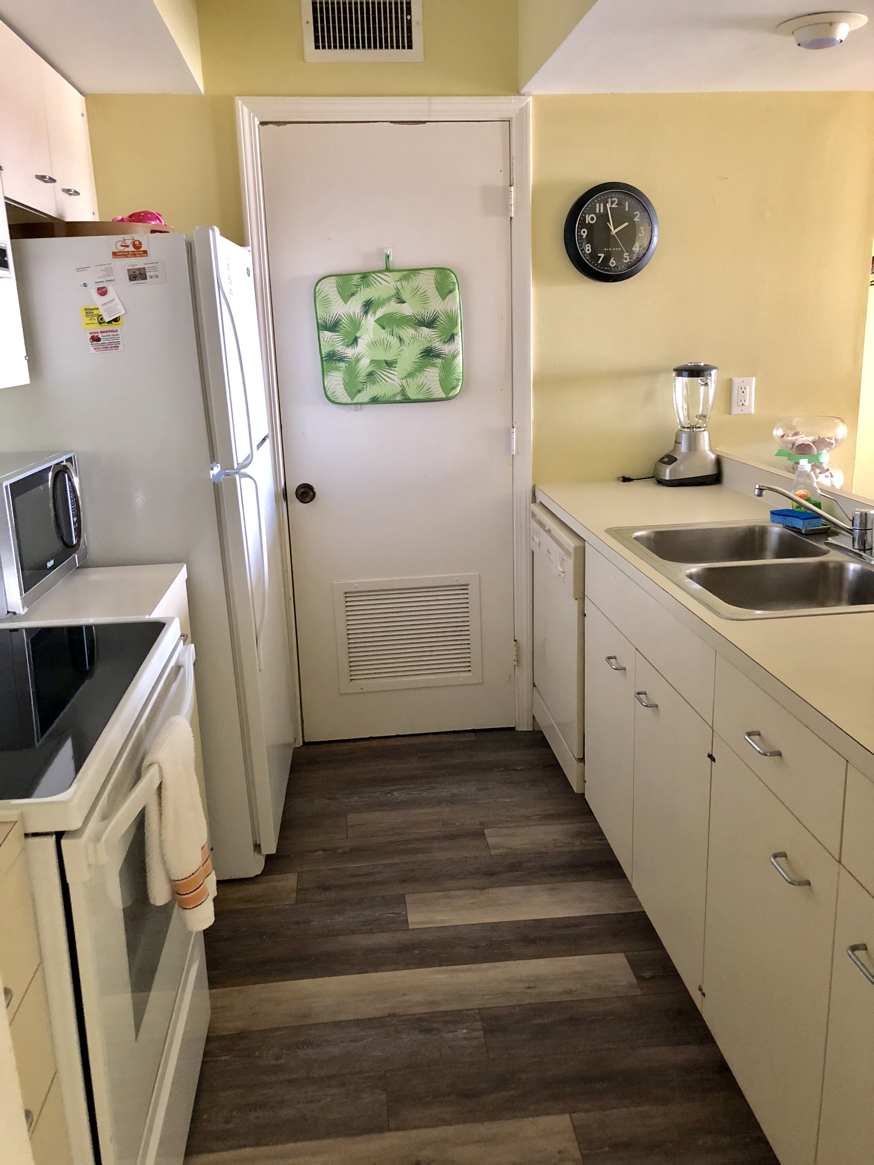 The galley kitchen is well stocked including a washer/dryer in the closet.