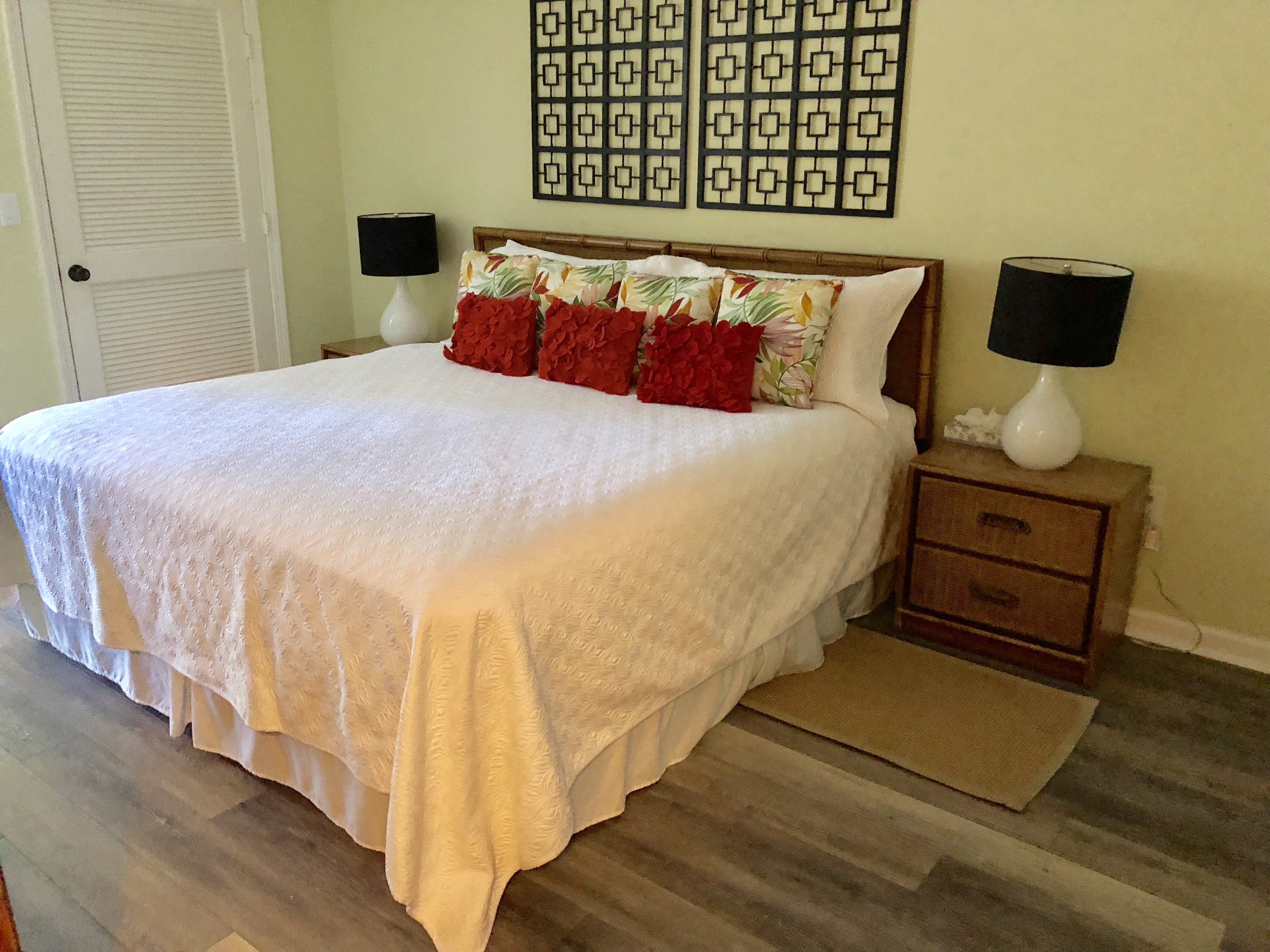 The master bedroom has a king bed TV and en suite bathroom.