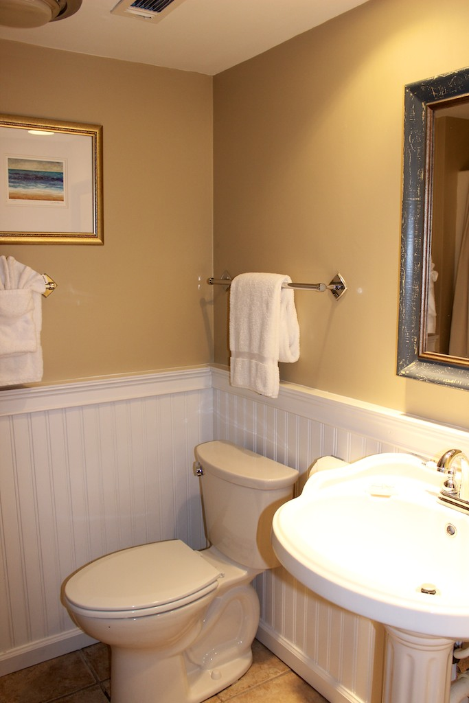 Off the hall is a full bath with a shower for your guests use.
