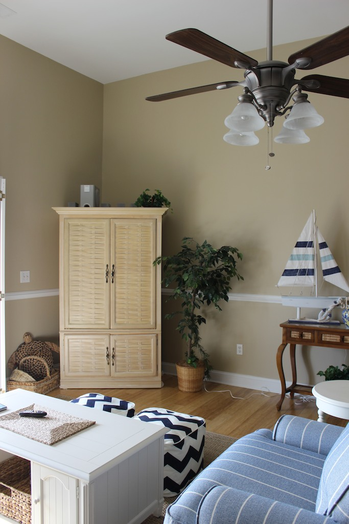High ceilings create an open living space. There is a new HDTV in the armoire.
