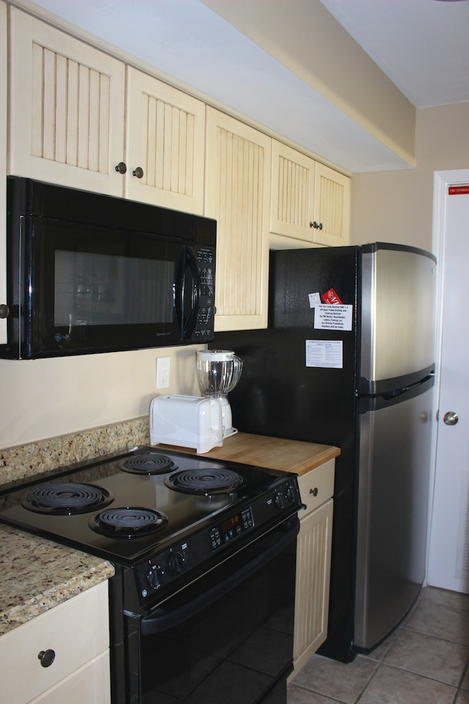 The kitchen has new appliances and there is a washer/dryer in the closet.