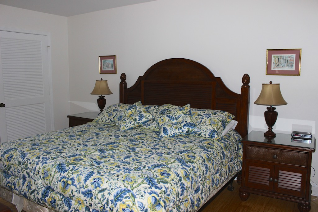 The master bedroom has a king sized bed.