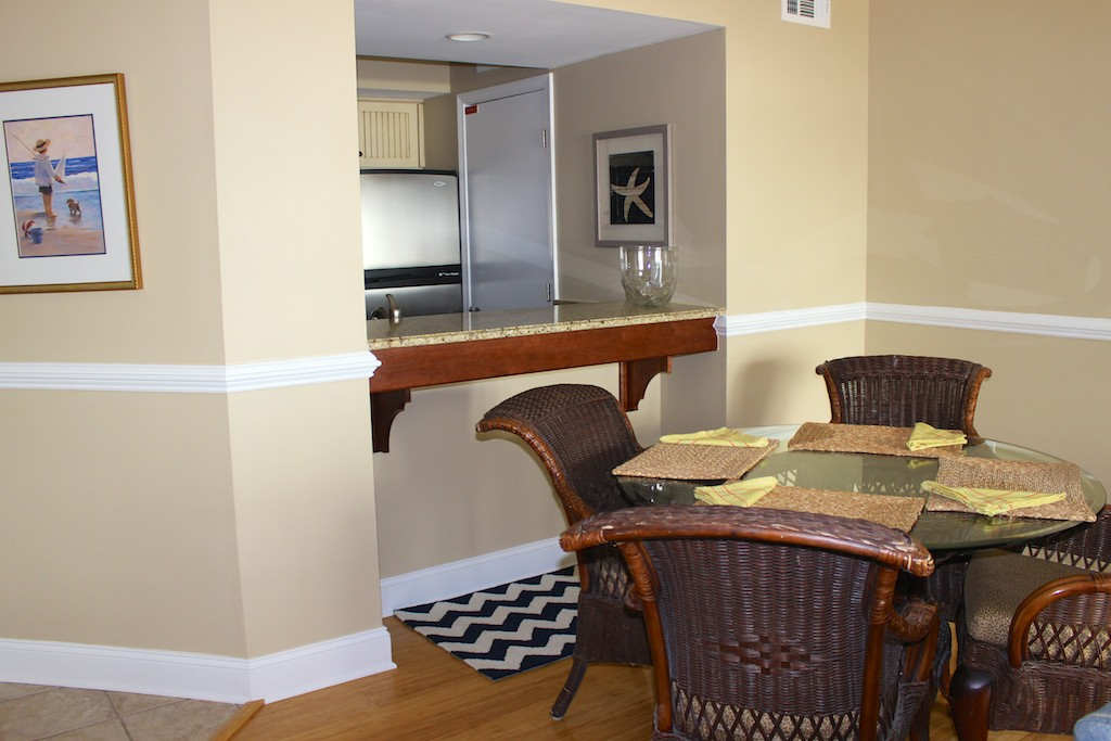 The table seats 4 & the pass through to the kitchen makes serving meals easy.