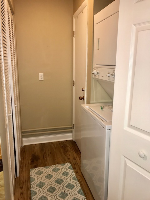 Full size washer dryer in hall closet.