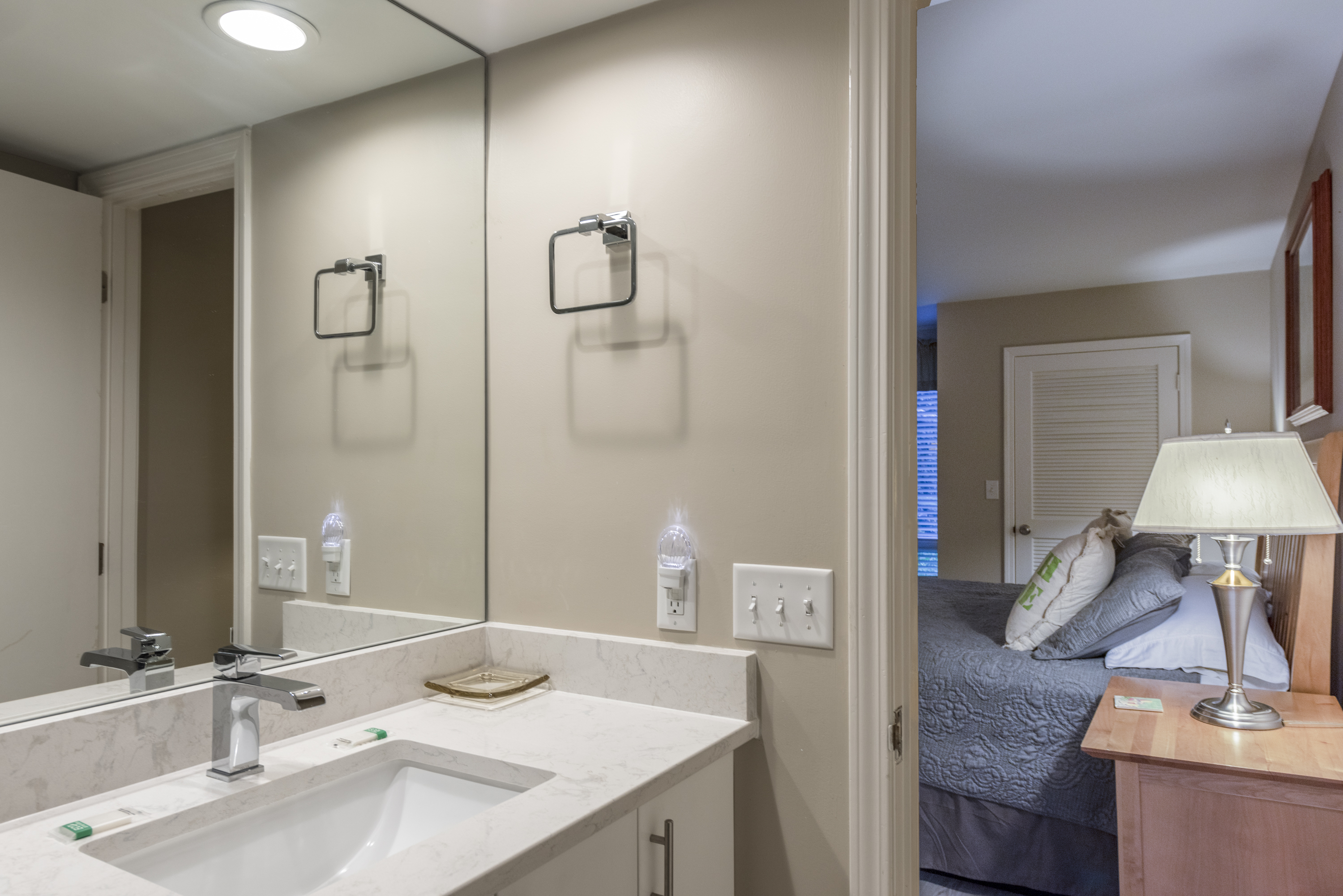 Newly remodeled bathroom off master bedroom features new vanity.