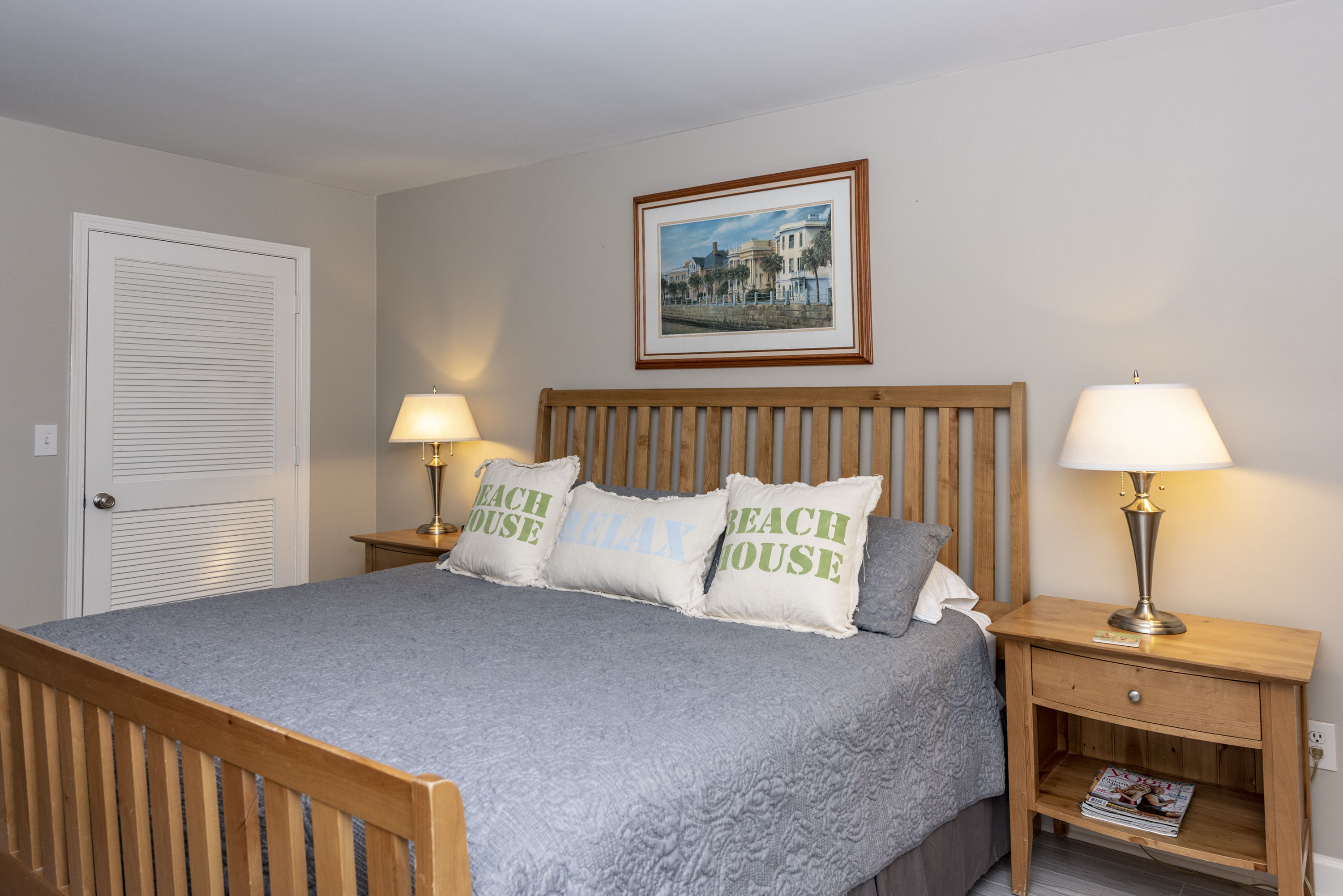 The spacious master bedroom has a king sized bed.