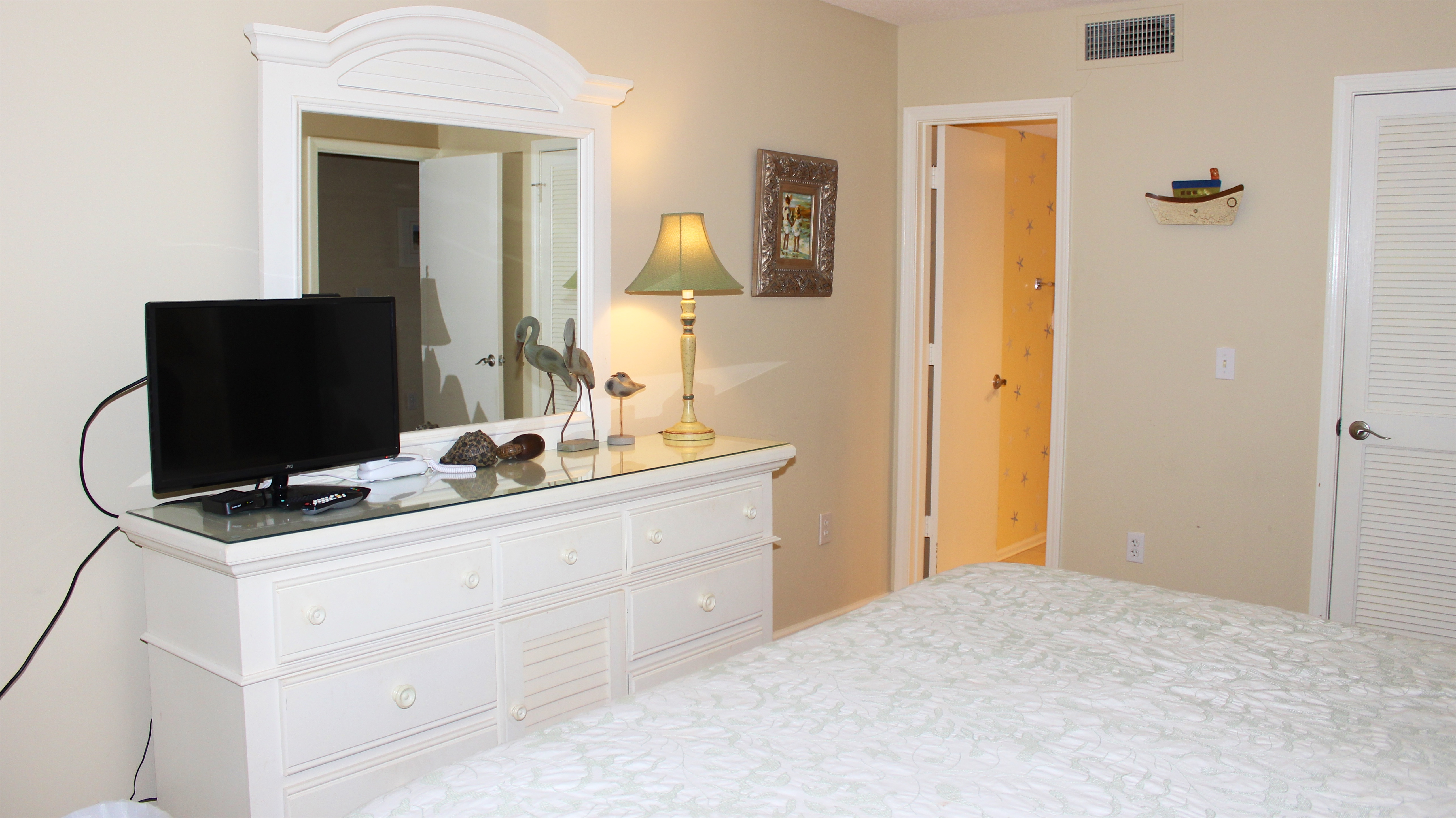 There is a flat screen TV for viewing shows and an adjoining bathroom.