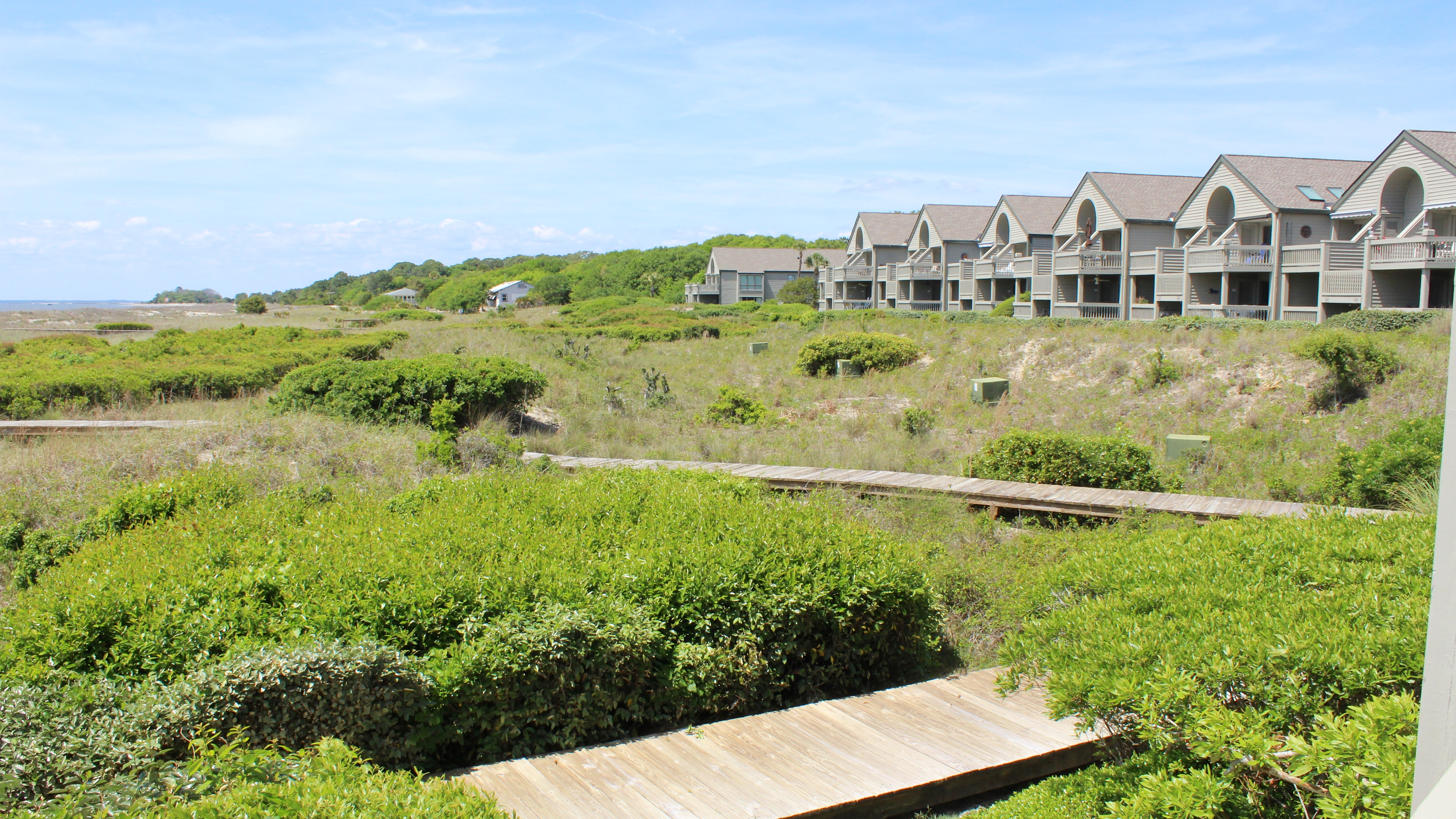 Step off the porch to the boardwalk leading to the beach.
